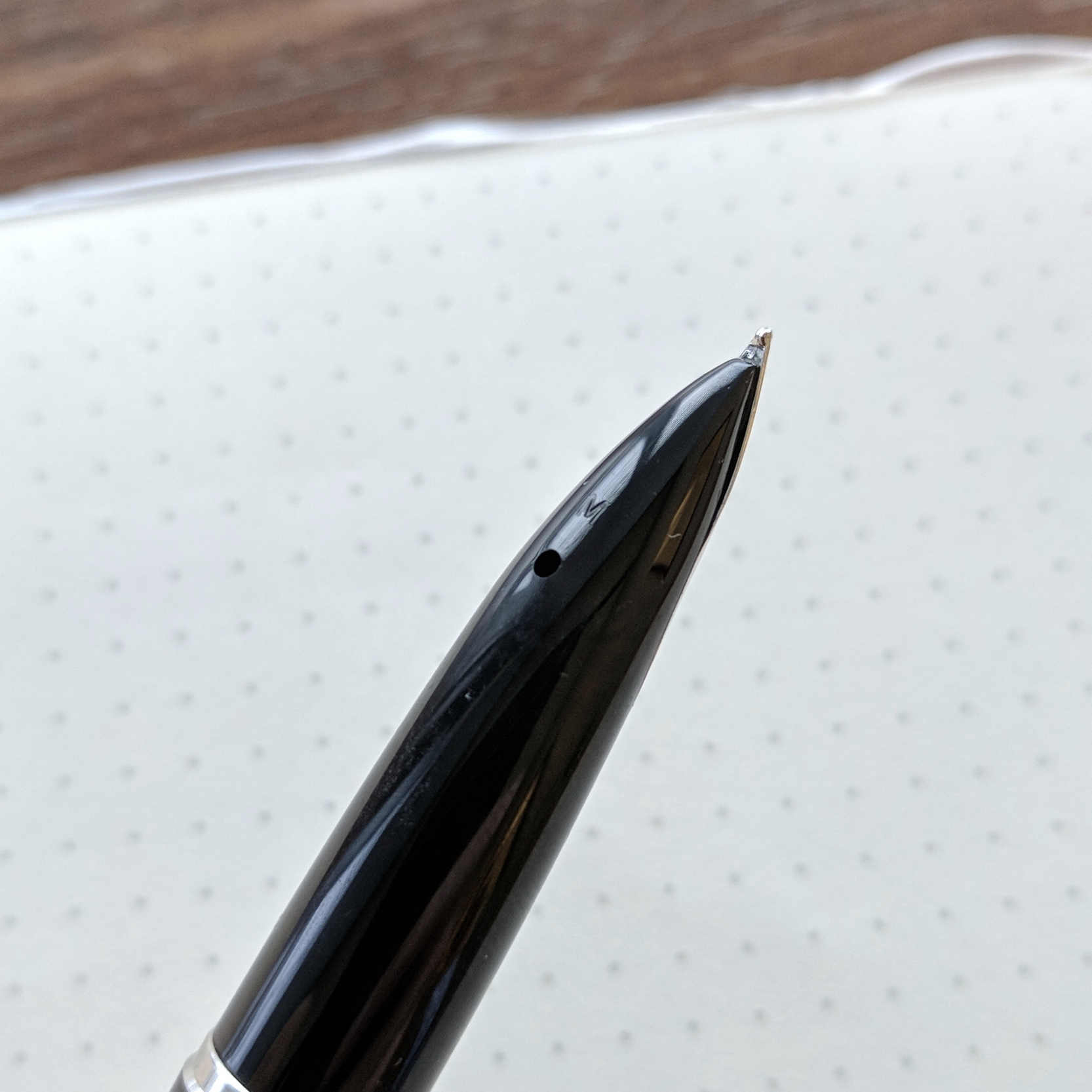 In order to get a full fill, make sure to fully submerge the breather hole on the bottom of the nib section. This can be challenging with certain ink bottles. (Ahem, Sailor.)