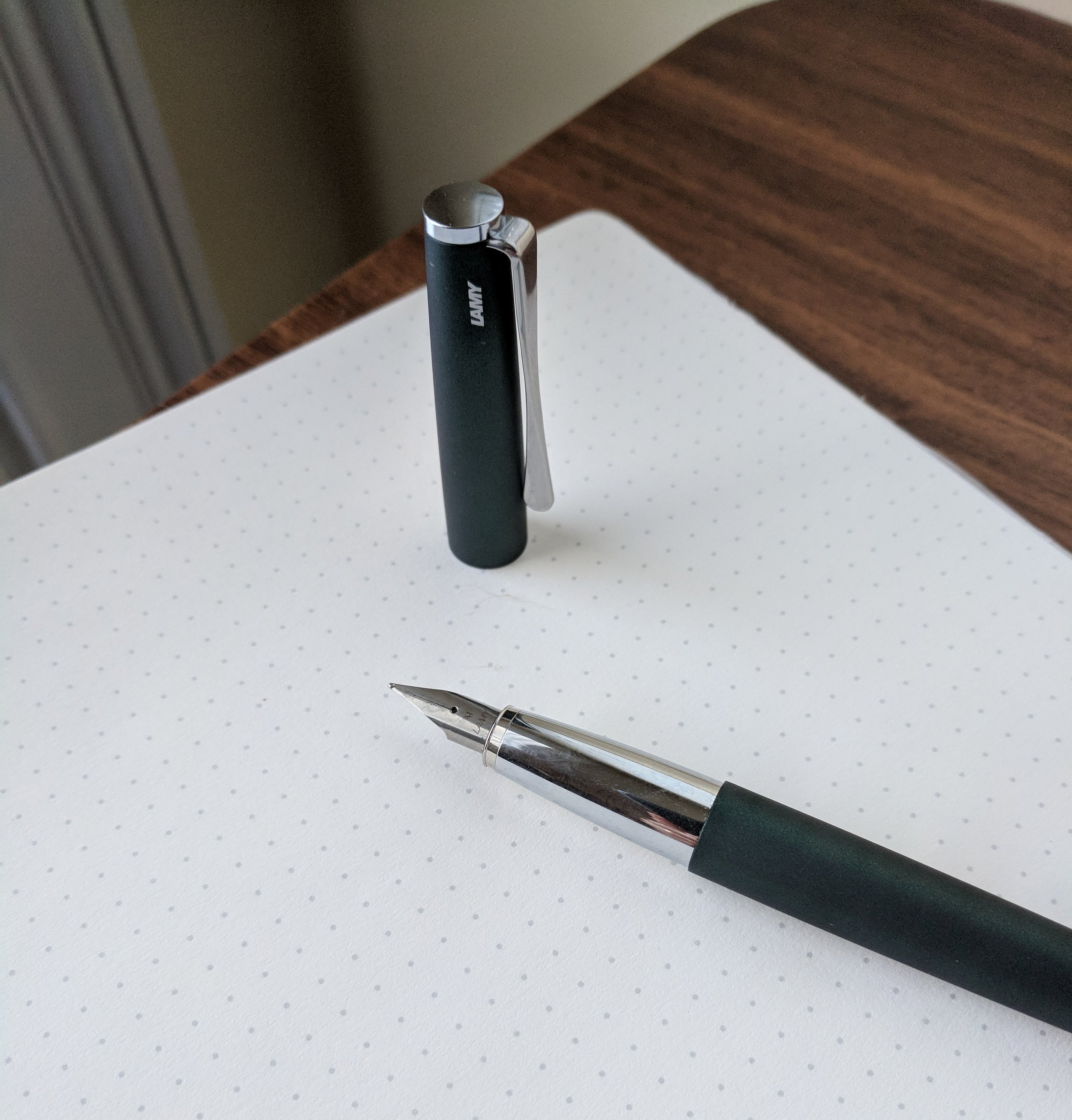 The sub-$80 Lamy Studio features the same stainless steel nib as on the Safari, AL-Star, LX, etc. For another $90,  you can separately purchase one of Lamy's 14kt nibs , which are outstanding, but the price is pretty steep.