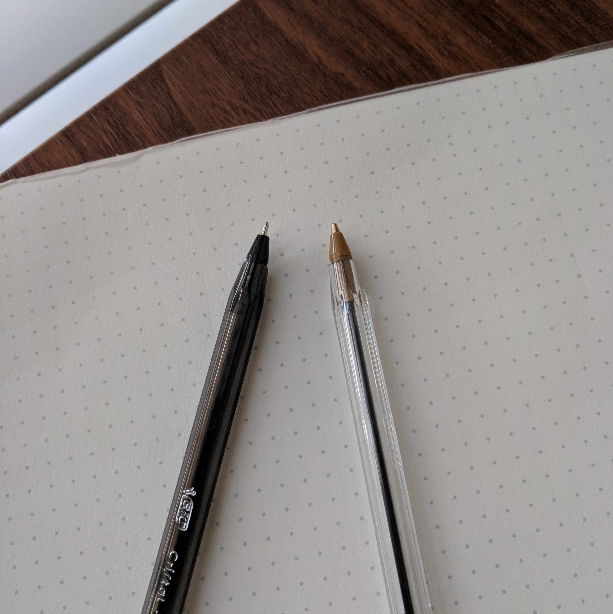 "Two current Bic Cristal models: on the left the .8mm Xtra Precision, which sports a needle tip, and on the right, the most common Bic Cristal available, the 1.0mm ""medium""."