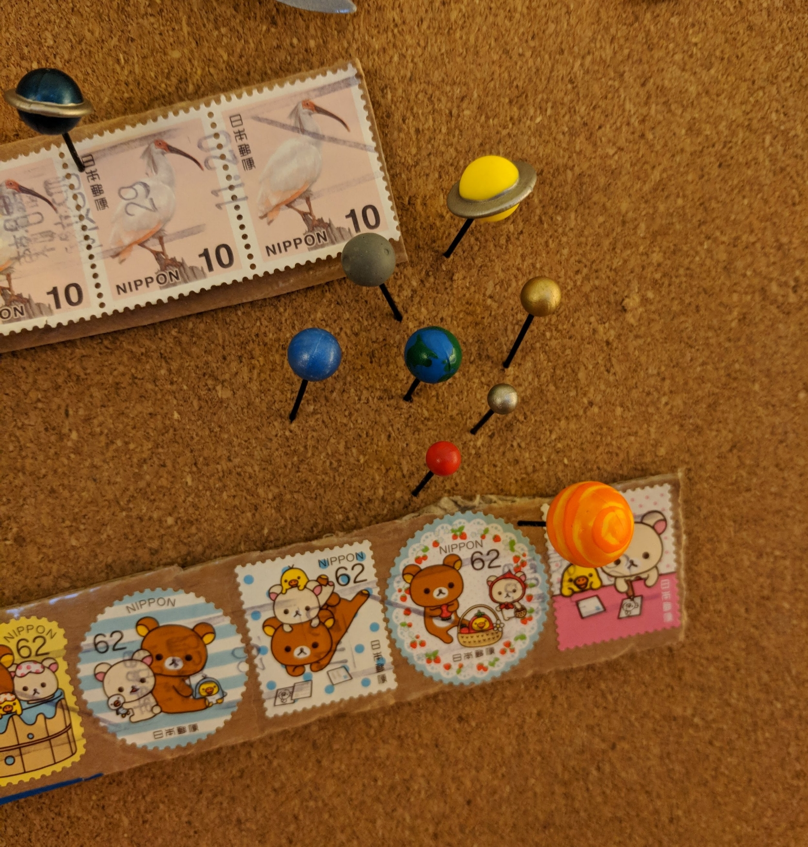 Planet Push Pins  (and the  Moon Push Pin  - not to scale) in action, with the stamps that carried my order from Tokyo!