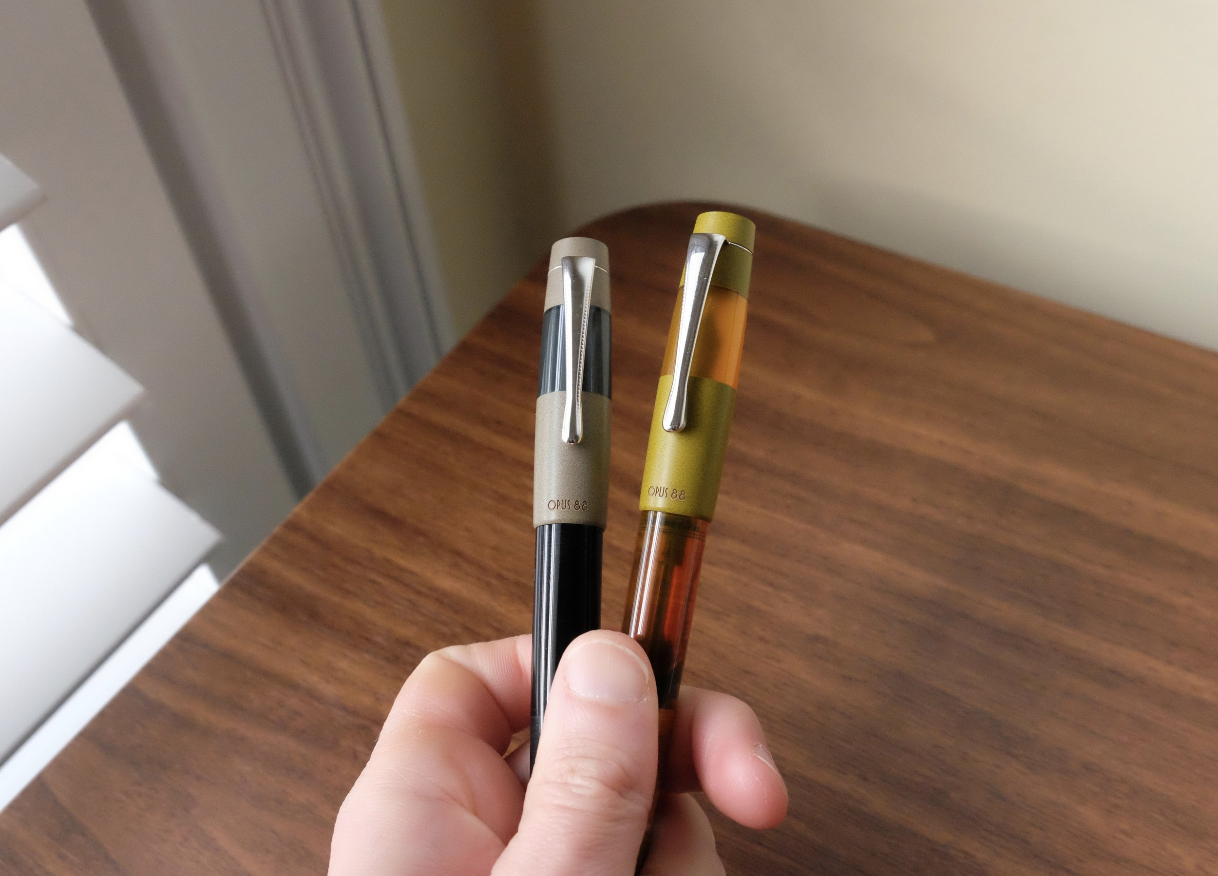 """Both Opus 88 models feature minimal branding, just """"Opus 88"""" on the cap. On the Koloro pens, the branding is engraved. On the larger demonstrator, shown below, it's screen printed, which doesn't look as nice and likely won't be as durable."""