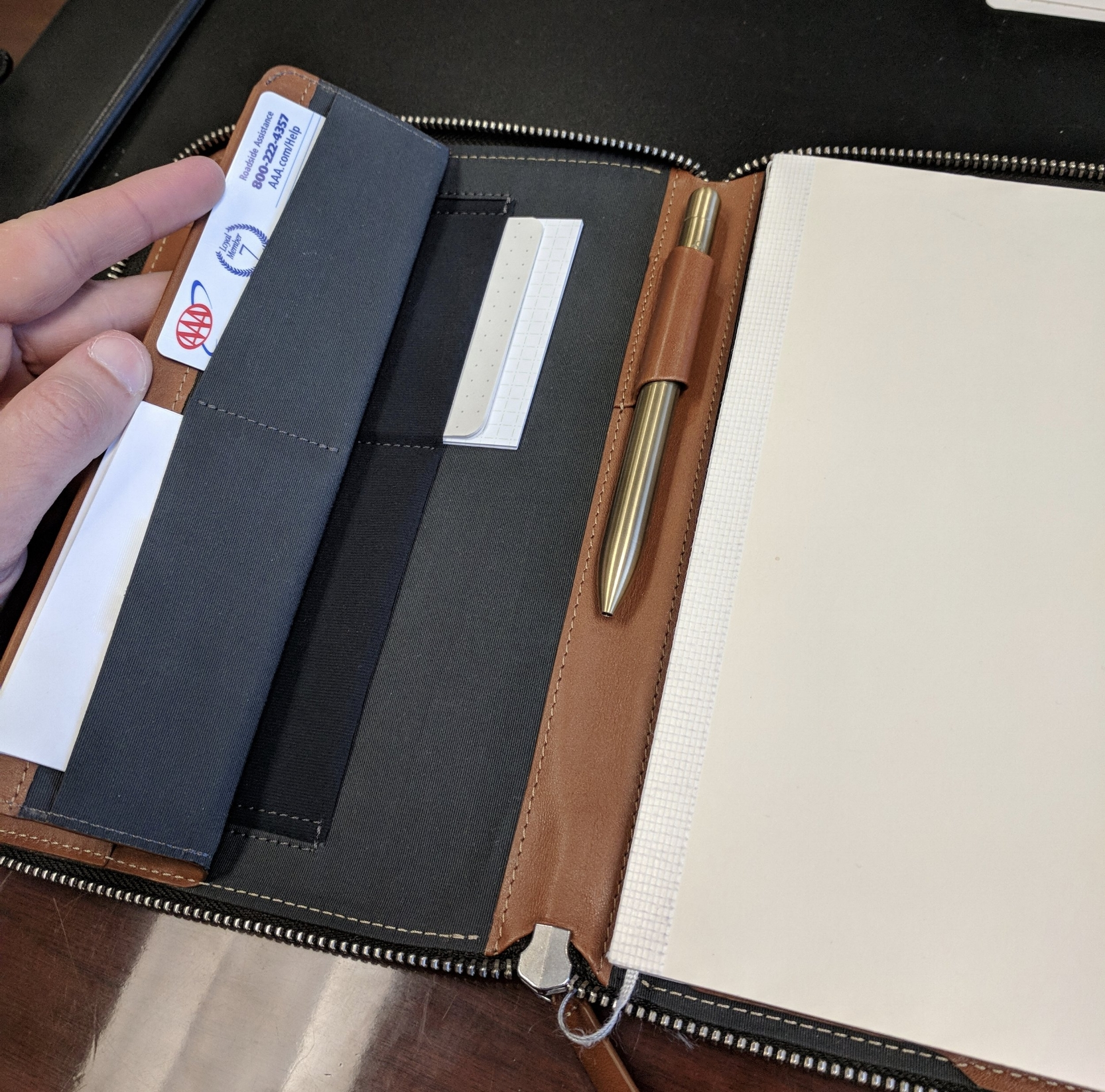 The left inside flap has pockets to hold business cards, notecards, post-its, your phone, a pocket notebook, etc. I'm sure you could also use them to hold a power bank, headphones, charging cables, and other small odds and ends if you use your folio to hold your tech products when traveling.
