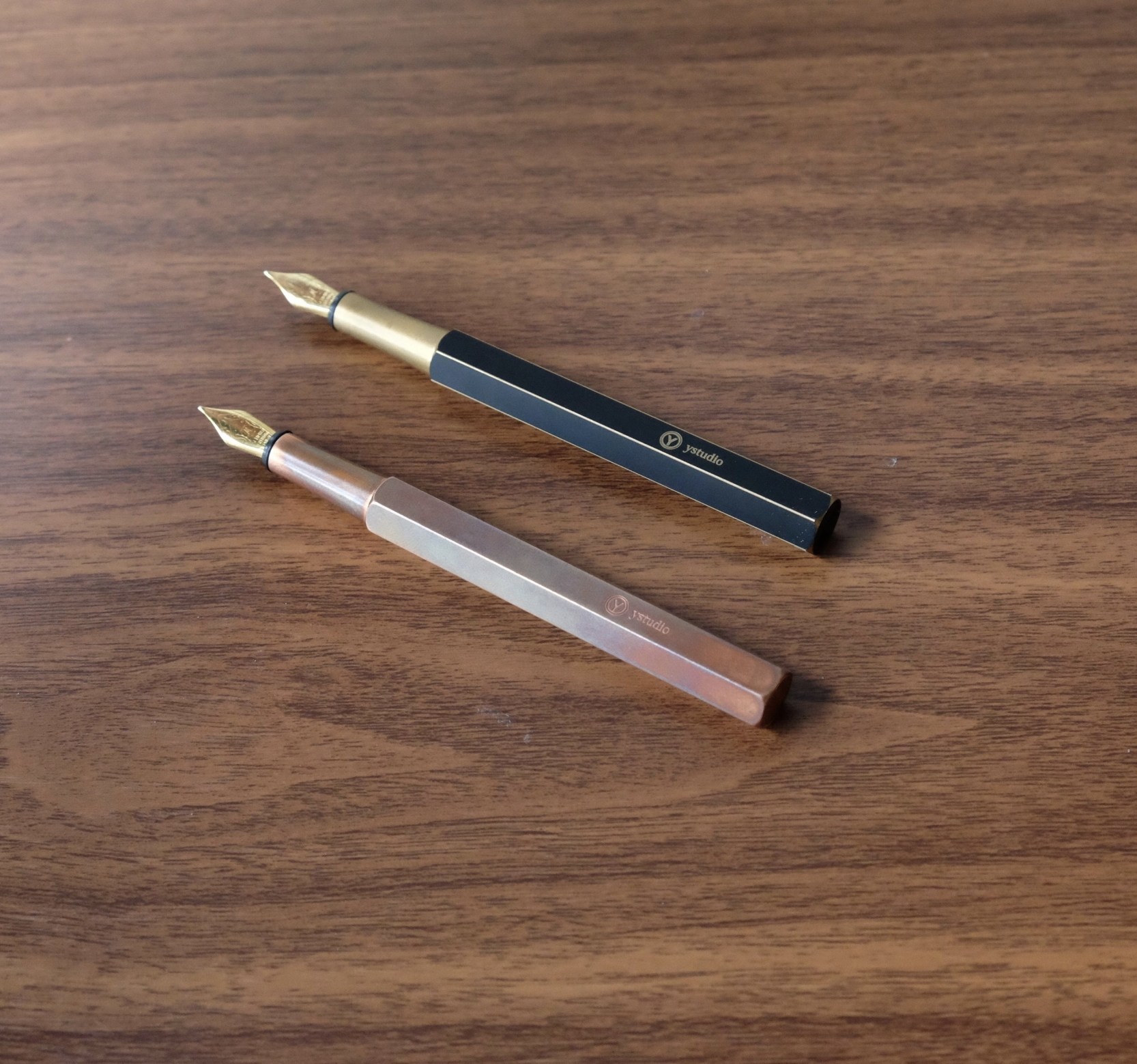 "The yStudio Portable fountain pen in ""Brassing"" finish (top) and Copper (bottom)."