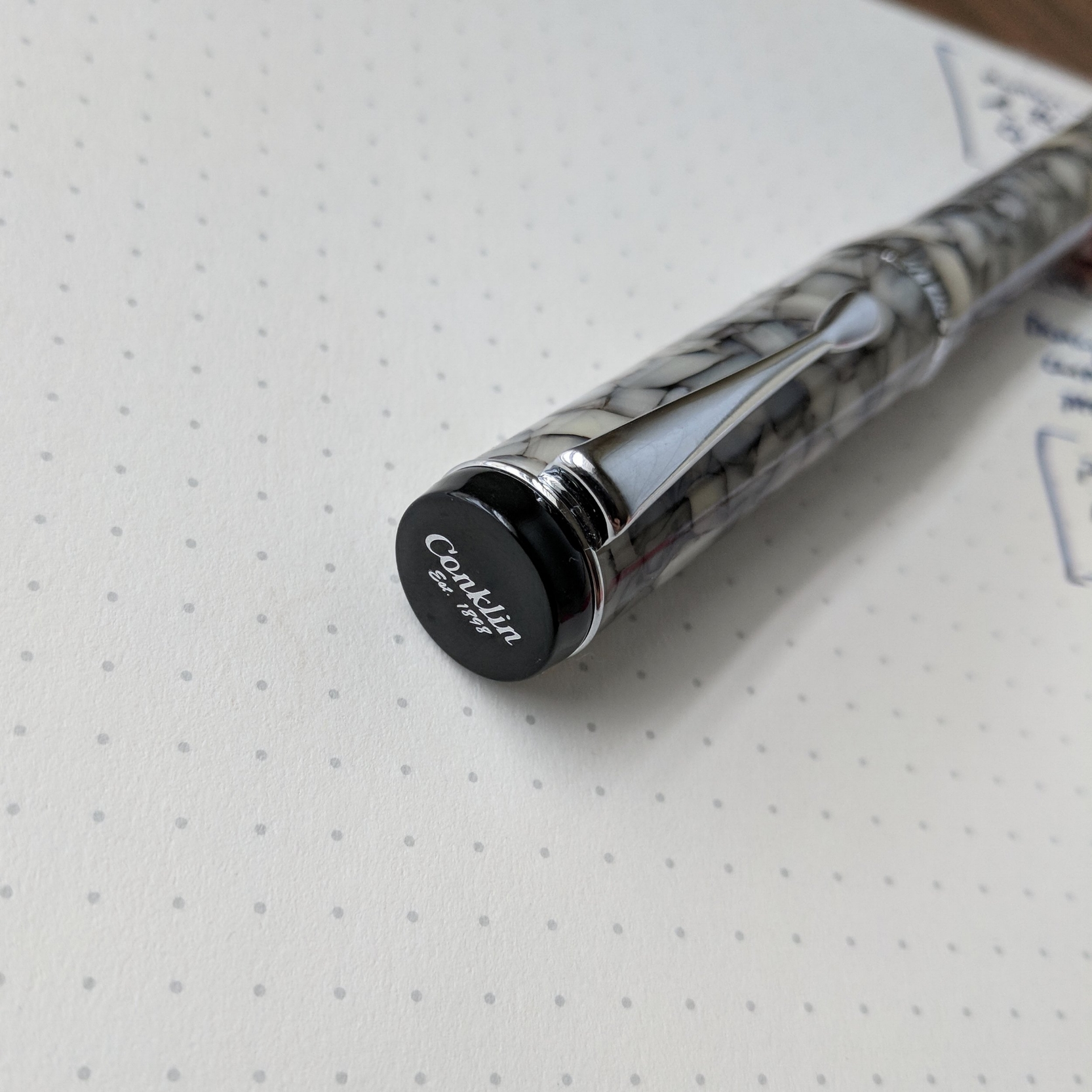 "Honestly, I probably could have gone without this engraved cap finial on the Duragraph, especially since the pen already has ""Conklin"" engraved on the cap band. But at the $50 price point, you can't always expect absolute elegance."