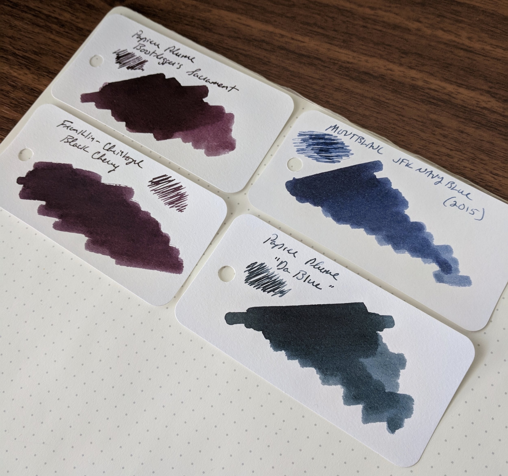 "Some color comparisons: Bootlegger's Sacrament is pretty close to  Franklin-Christoph Black Cherry , though the Papier Plume ink has more purple. When I first saw ""Da Blue,""  Montblanc JFK Navy Blue  came to mind, though the Papier Plume ink has a lot more green and grey."
