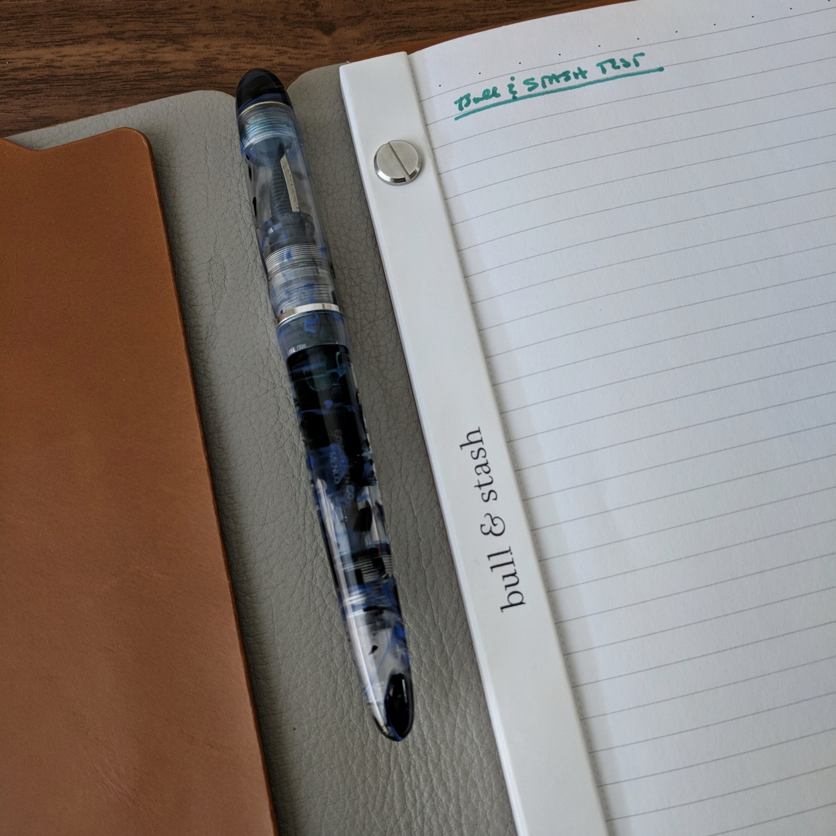 The design of the Bull & Stash Leonard makes it very easy to clip a pen to the inside, even a moderately large pen  like this Edison Menlo . The notebook will still close with the pen, and the cover has magnets inside to keep it shut.