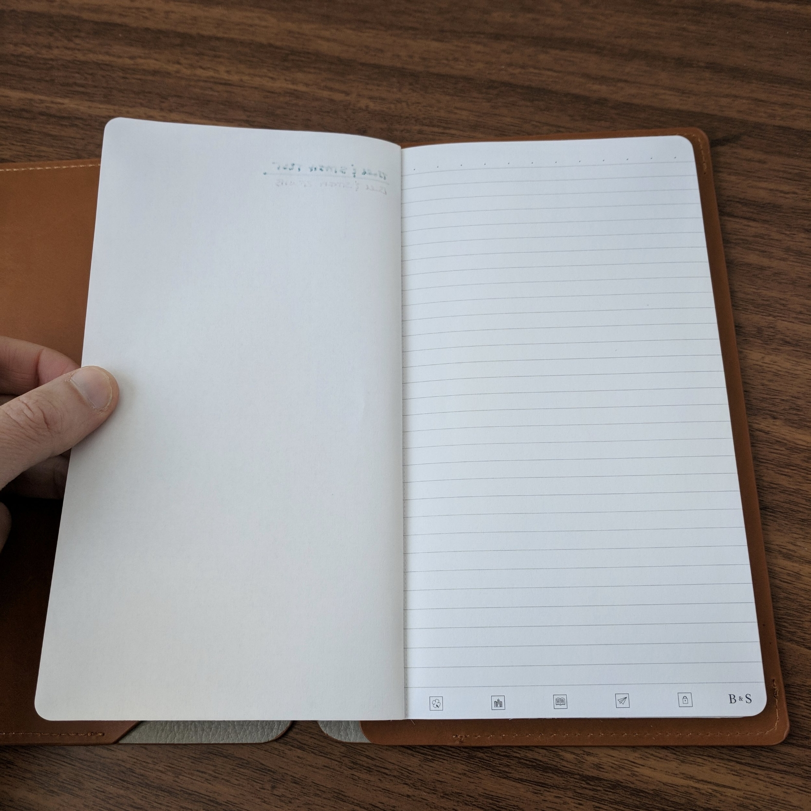 """The proprietary Bull & Stash refill hasn't changed. The regular 60lb paper is not the most fountain pen friendly, and there will be some feathering and bleedthrough. That said, you're not meant to write on both sides of the page. It's more of a """"notepad"""" setup, where each page is perforated and can be torn out. Bull & Stash separately sells 110lb """"Fountain Pen"""" refills, which I've not had the opportunity to try."""