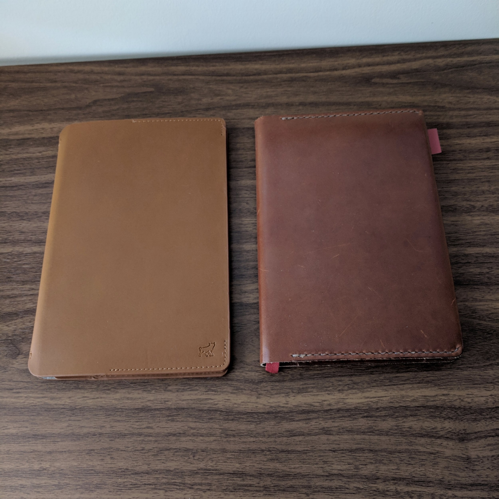 The Bull & Stash Leonard, left, compared against the Baron Fig Confidant, in  a One-Star Leather Goods Cover .