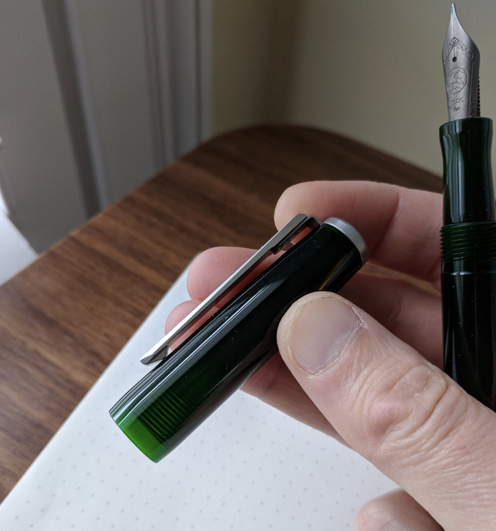 "The translucent ""Deco Green"" thermoplastic is some of the prettiest pen material I've seen in a while. In certain light, it appears almost black, but can otherwise appear almost a bright ""beetle green,"" as I've heard this color described elsewhere. I also love the faceting on the clip."