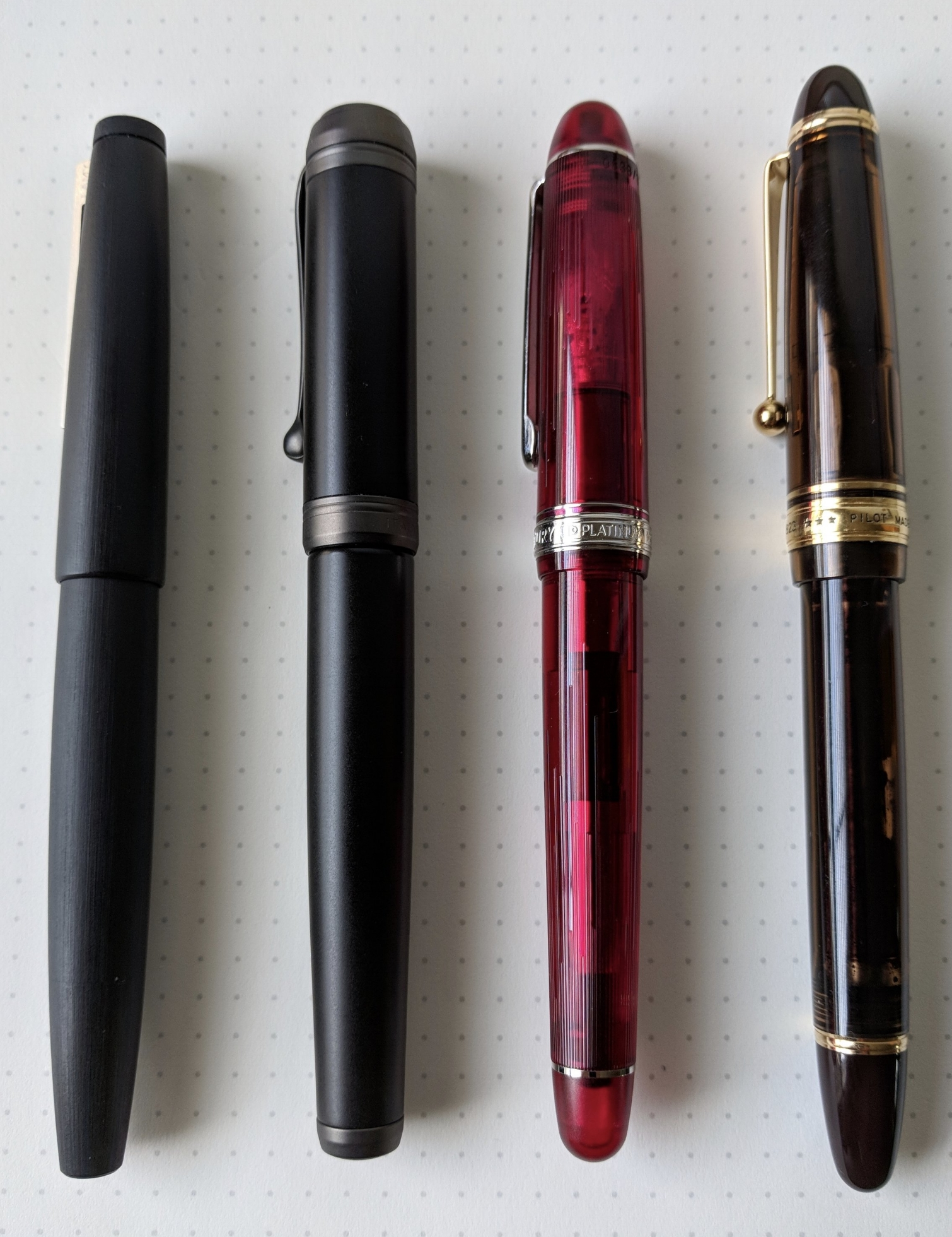 Another size comparison, from left:  Lamy 2000 , Aurora Talentum Black Ops,  Platinum 3776  (Shungyo limited edition), and  Pilot Custom 823 .