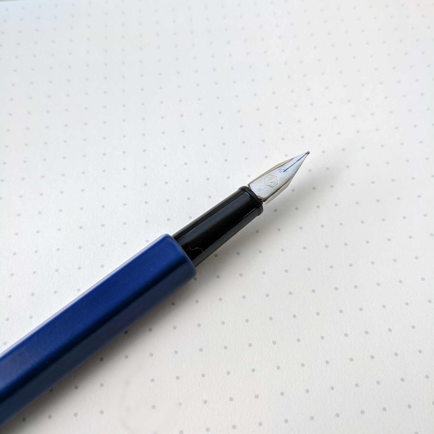 The shape of the nib on the Caran d'Ache 849 is almost Lamy-esque. While the nib is NOT flexible, it does have some slight bounce to it.