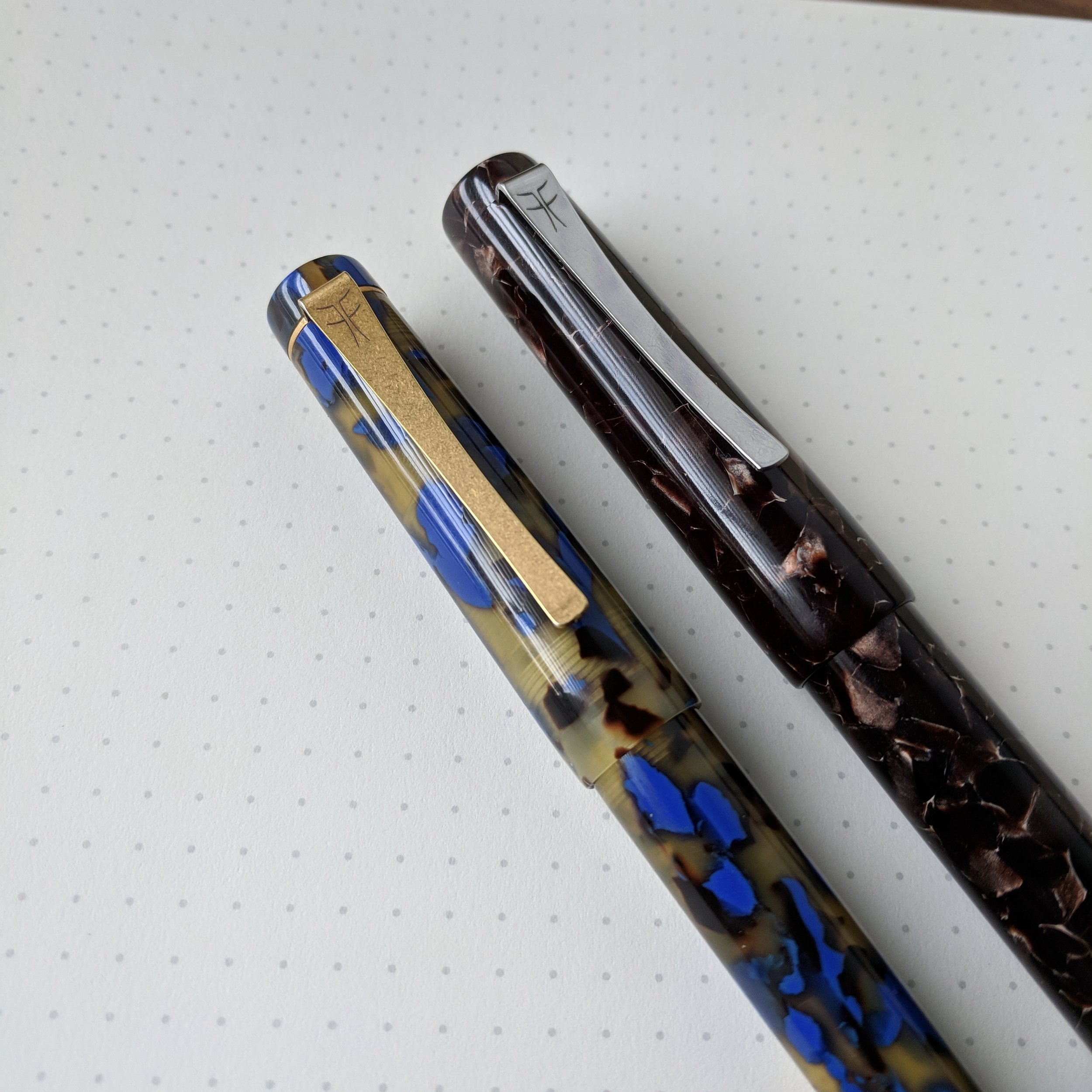 "Blue tortoise Petrarque and ""Dartmoor"" PKS side-by-side. The simply engraved, curved clip is one of my favorite design elements of these pens."