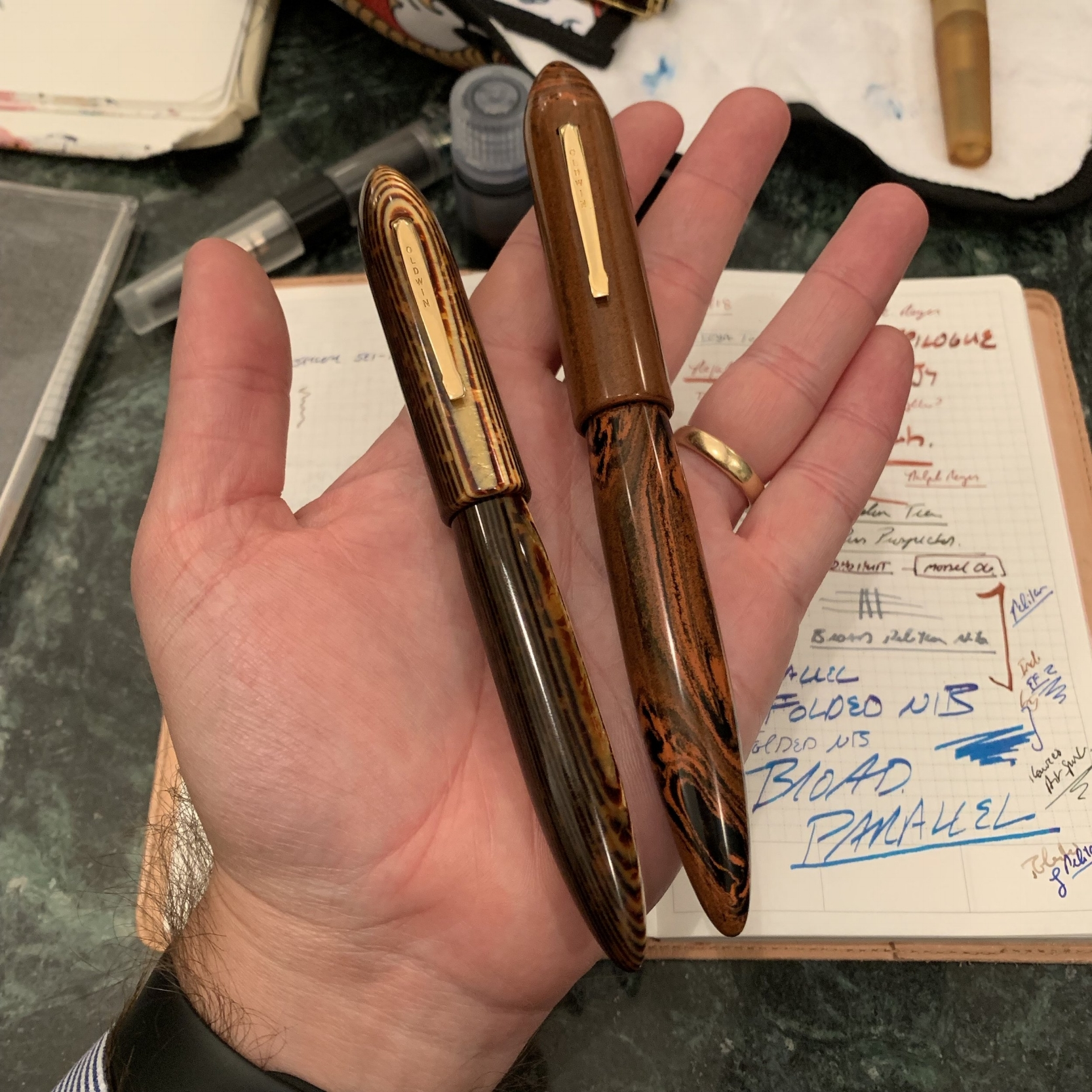 A pair of Oldwin pens in Ebonite and Arco celluloid.