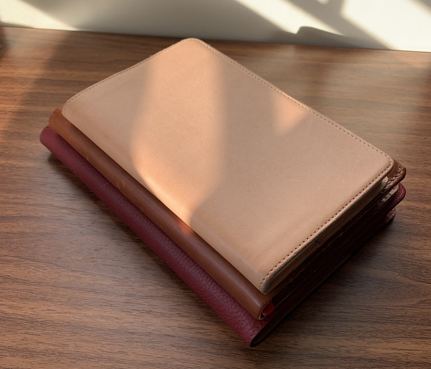 A comparison shot of three leather notebook covers that find their way into my daily rotation: The British Belt Company A5 (bottom), a  custom One Star Leather Baron Fig Confidant Cover  (middle), and the  Gfeller English Kip leather cover for my Nanami Paper Cafe Note B6  (top).
