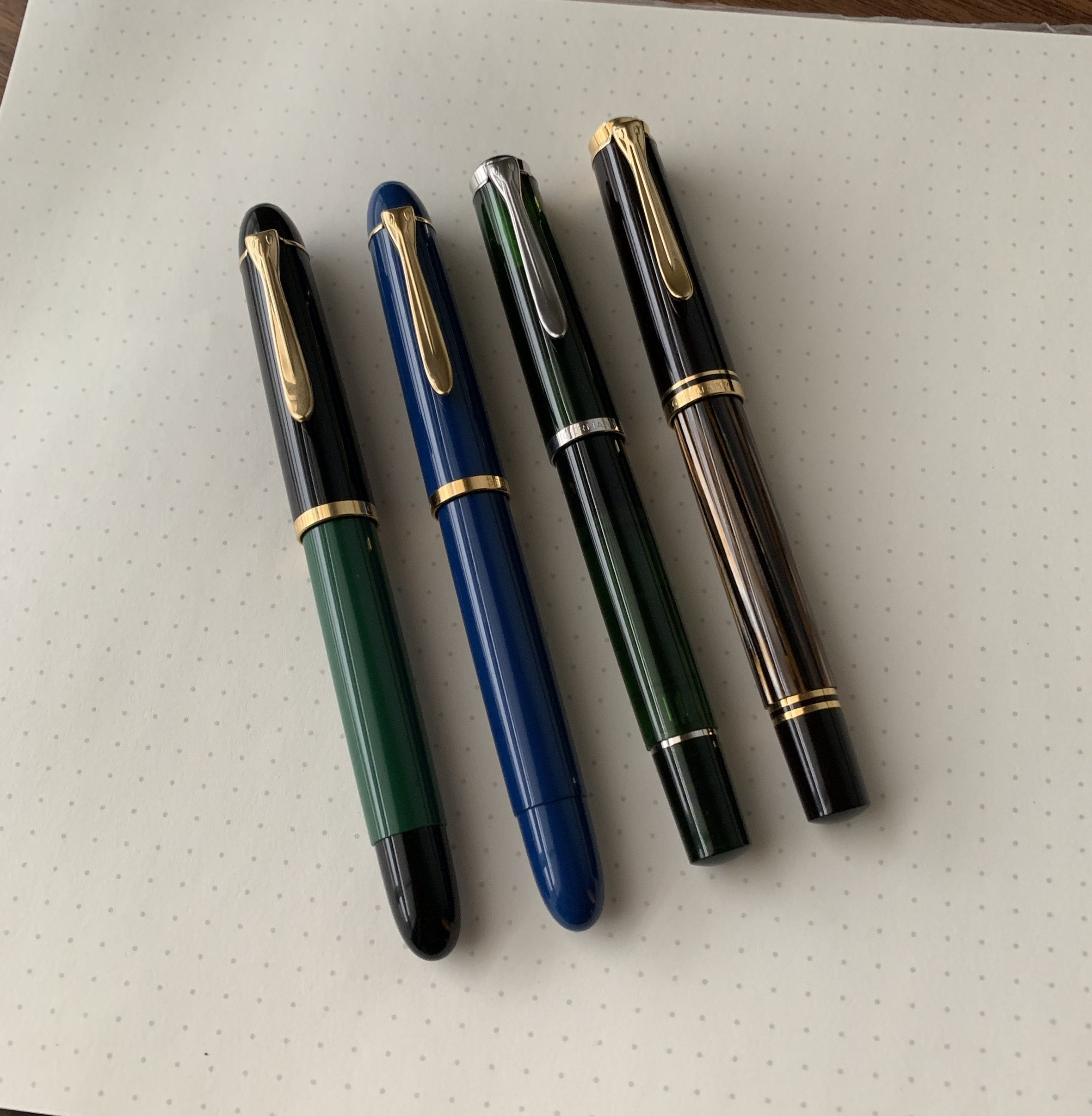 A comparison shot of (from left) the Pelikan M120 Green-Black; the M120 Iconic Blue; the M205 Olivine; and the M400 Brown Tortoise.