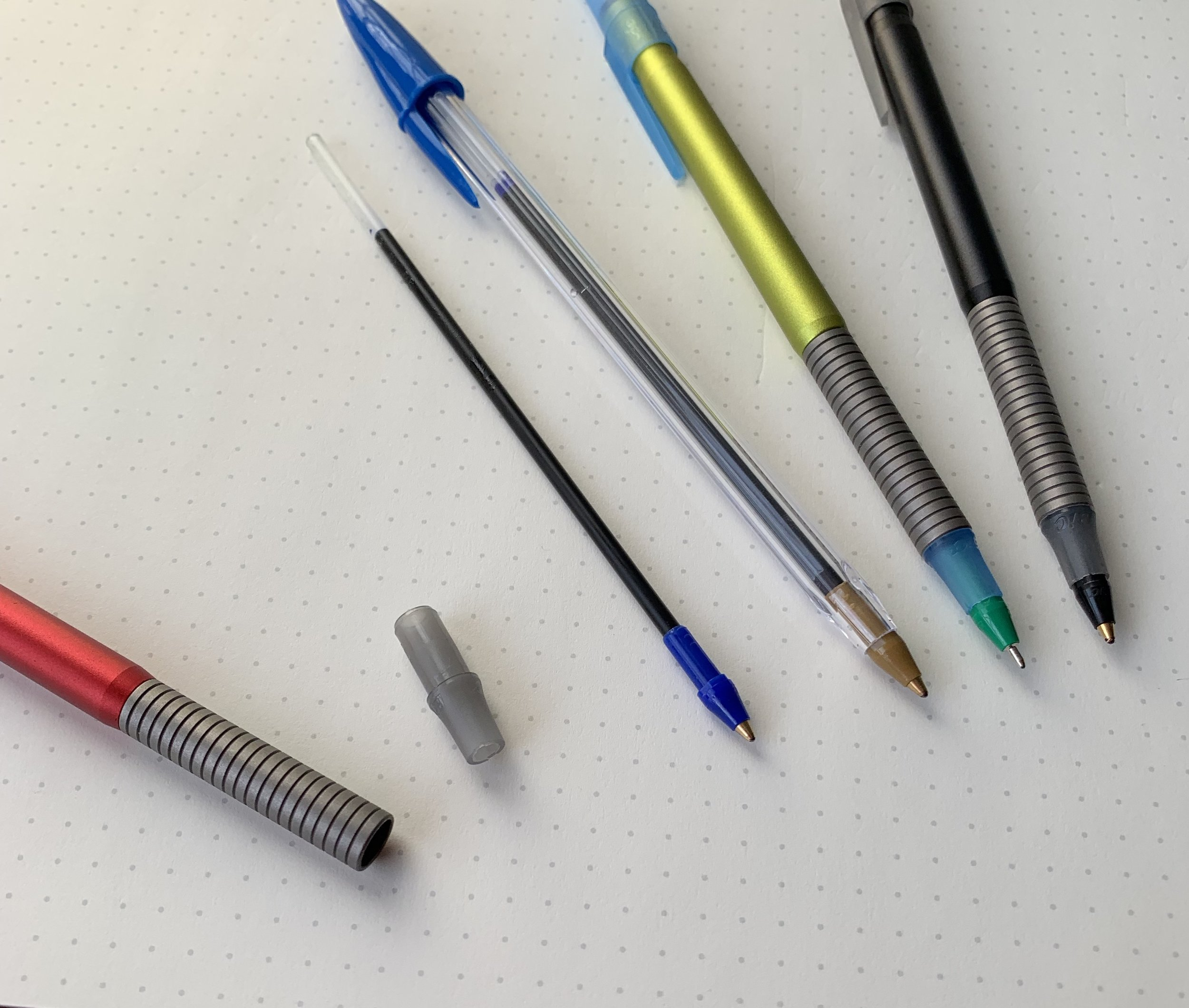 """How to disassemble a Baux Pen to incorporate the refill: If you want to use the refill from a Bic Cristal, you will need to borrow the """"collar"""" (pictured second from left) from a Bic Stic to seat the Cristal refill in the Baux Pen. You can then use the ultra fine ballpoint refills from pens like the  Bic Cristal """"Xtra Precision"""" , in all their multicolor glory."""