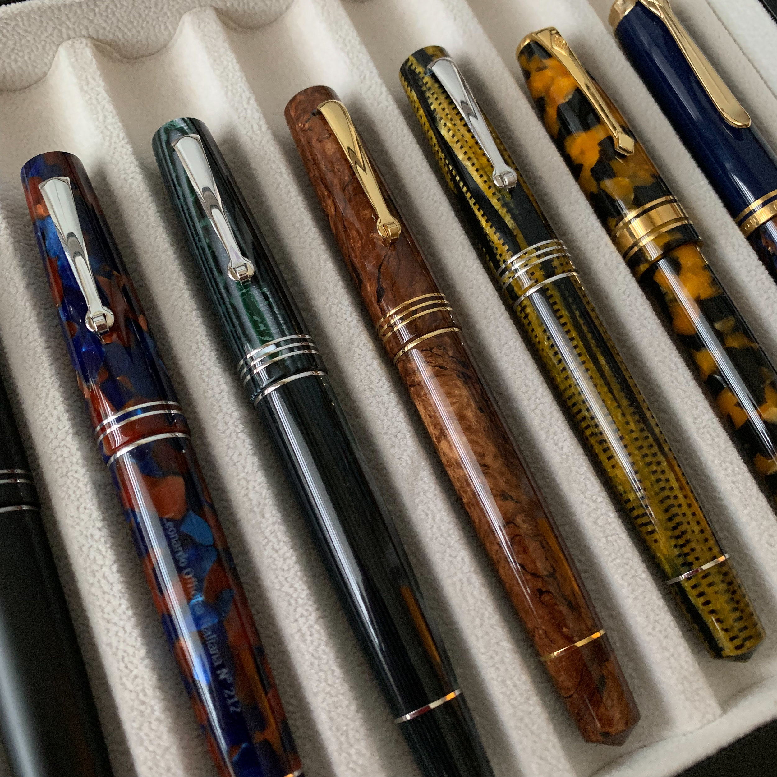 The work Leonardo has done in Italian celluloid is what initially drew me to the brand. The three pens in the center are the piston-filler Momento Zero in, from left, Omas Arco Verde celluloid, Omas Burlwood celluloid, and Omas Burkina celluloid.