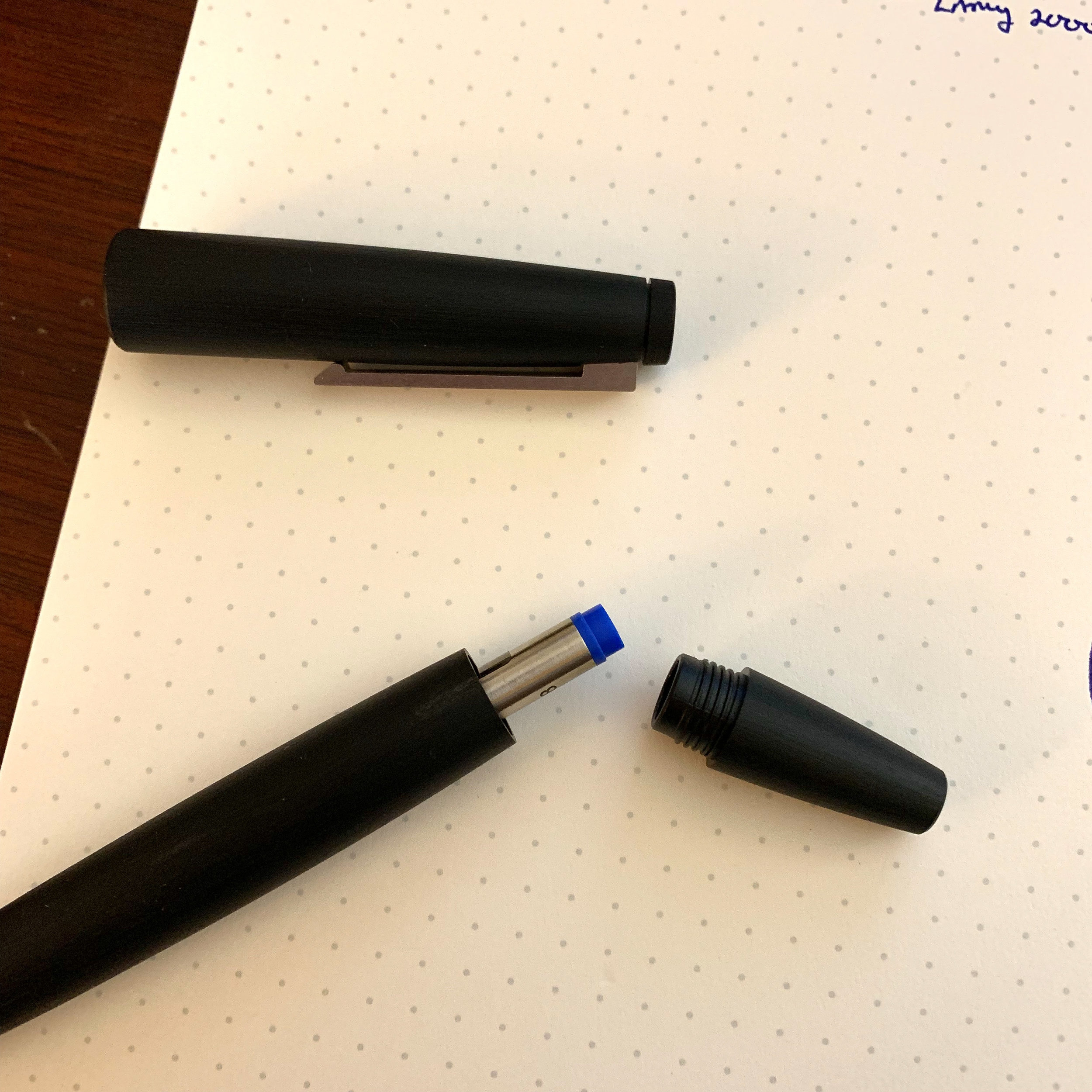 Swapping out the rollerball cartridge is pretty simple: just unscrew the back end of the pen and drop in the refill.