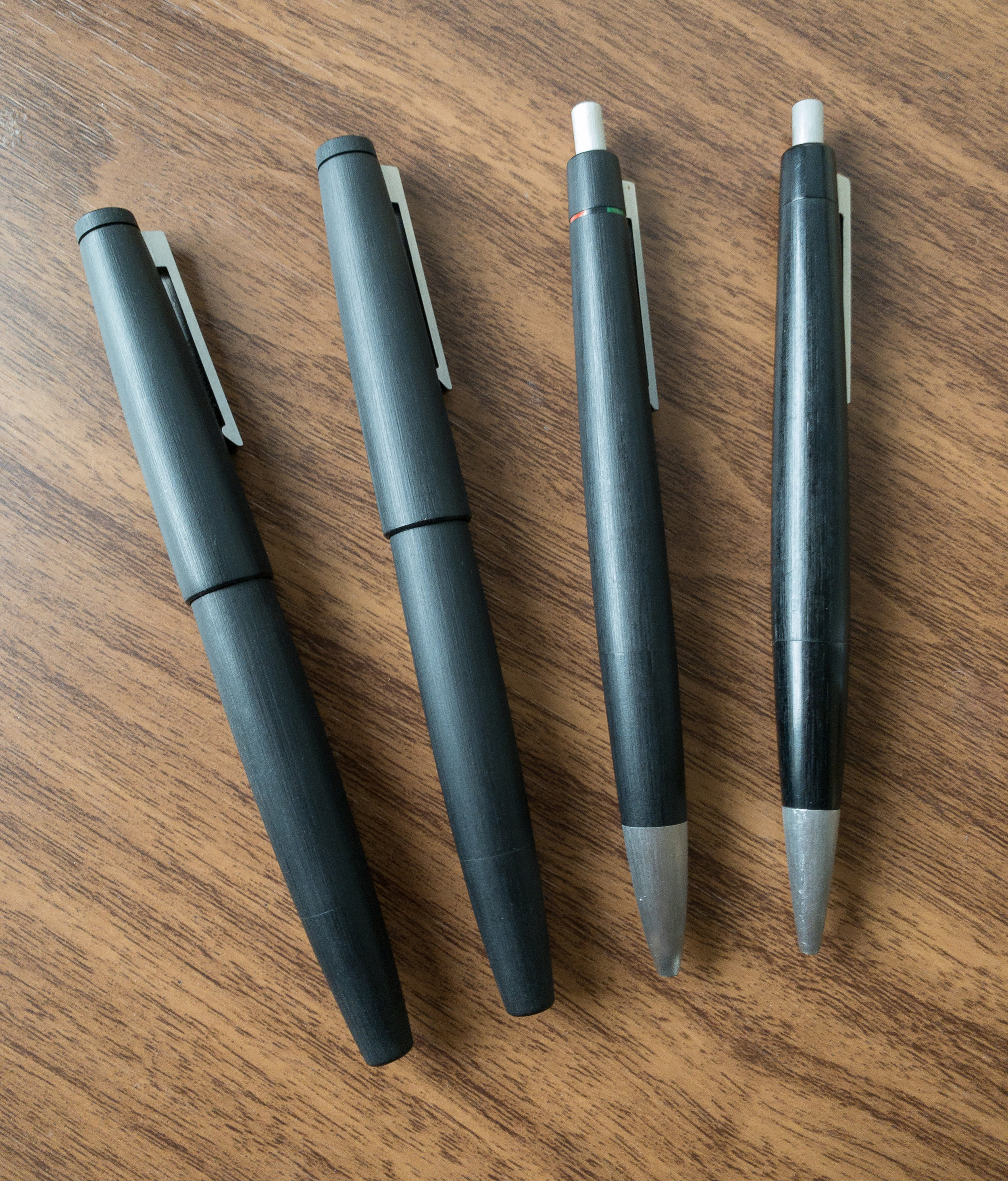 A Lamy 2000 Family Portrait: From left, the fountain pen, rollerball, 4 Color Ballpoint/multi pen, and standard ballpoint. The ultimate daily carry?