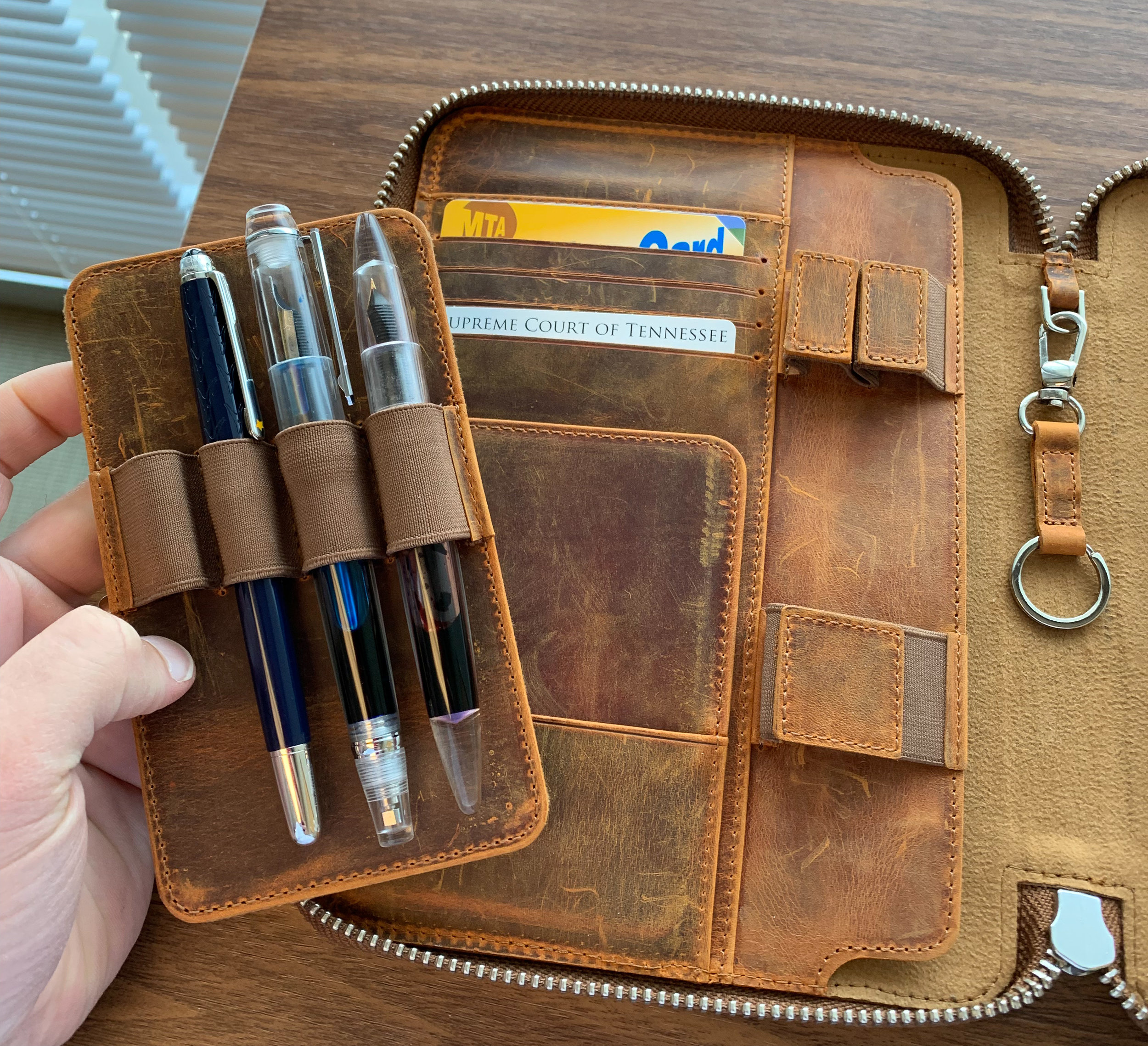 The pen-holder insert is removable, if you don't want to carry pens in your Zipfolio or just want to carry one or two pens in the larger loops.