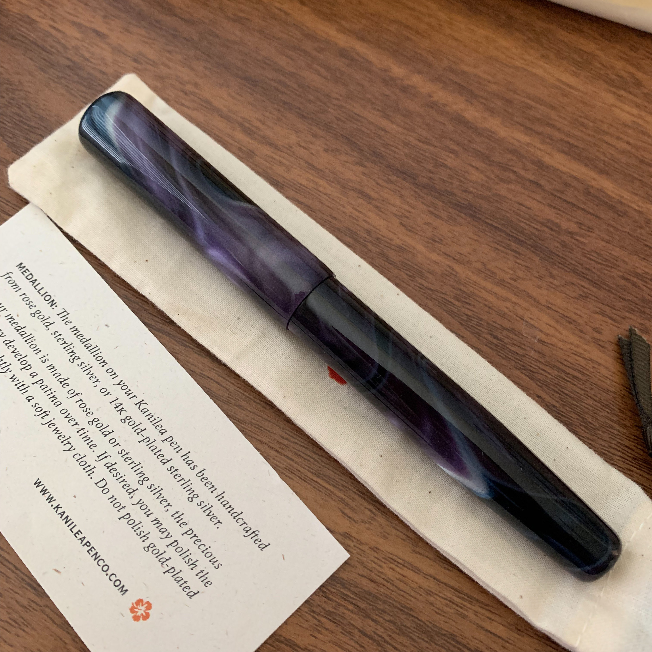 The flip side of the Aolani. Note how the swirls on one side of the pen are quite dark, but on the other side, shown here, you get more of the gray, purple, and iridescent silver.