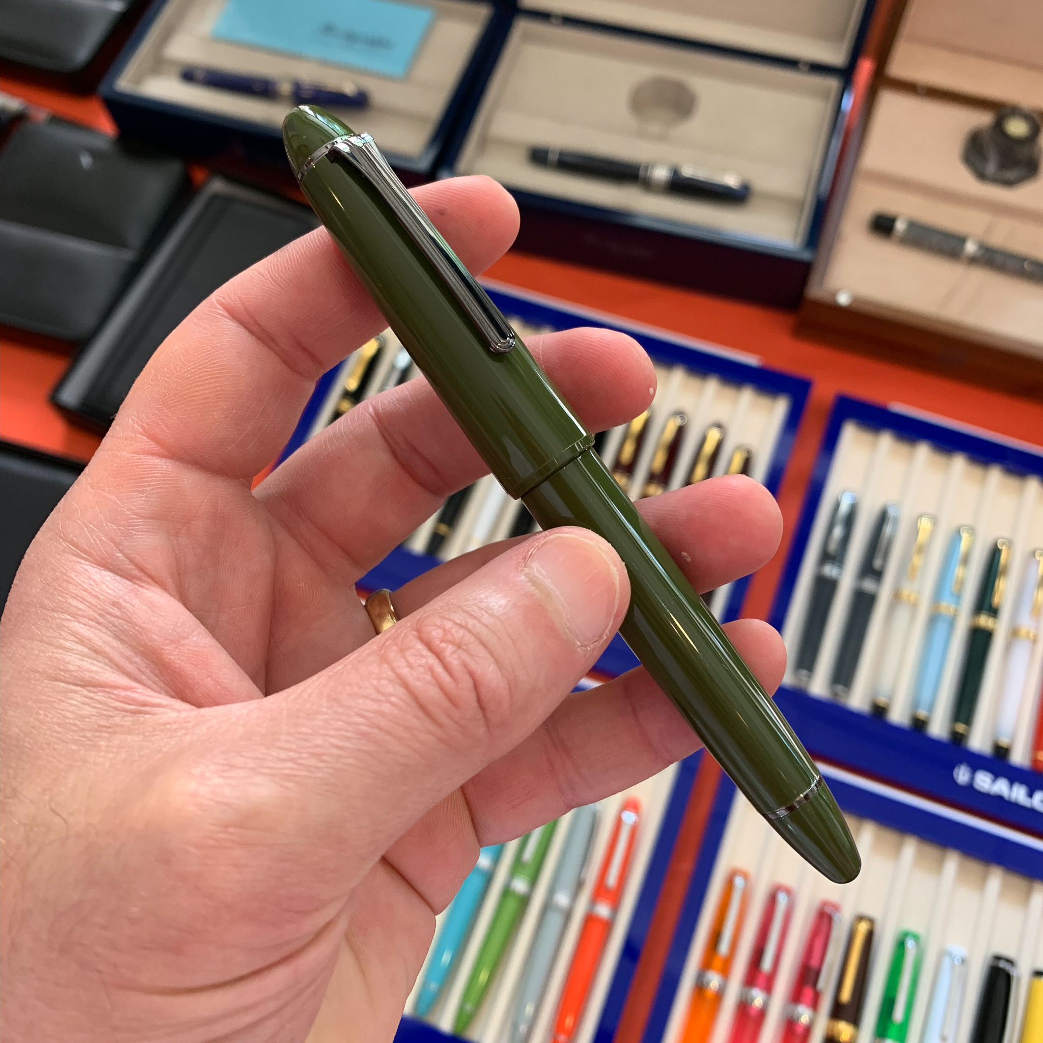 "The  Sailor 1911 Large in the ""Ringless Epinard"" Design . This pen gets a lot of attention, and looks good, but come of the design choices leave me scratching my head. For one thing, the pen has ruthenium trim but a rhodium nib, and I'm not sure how I feel about the cap edge."