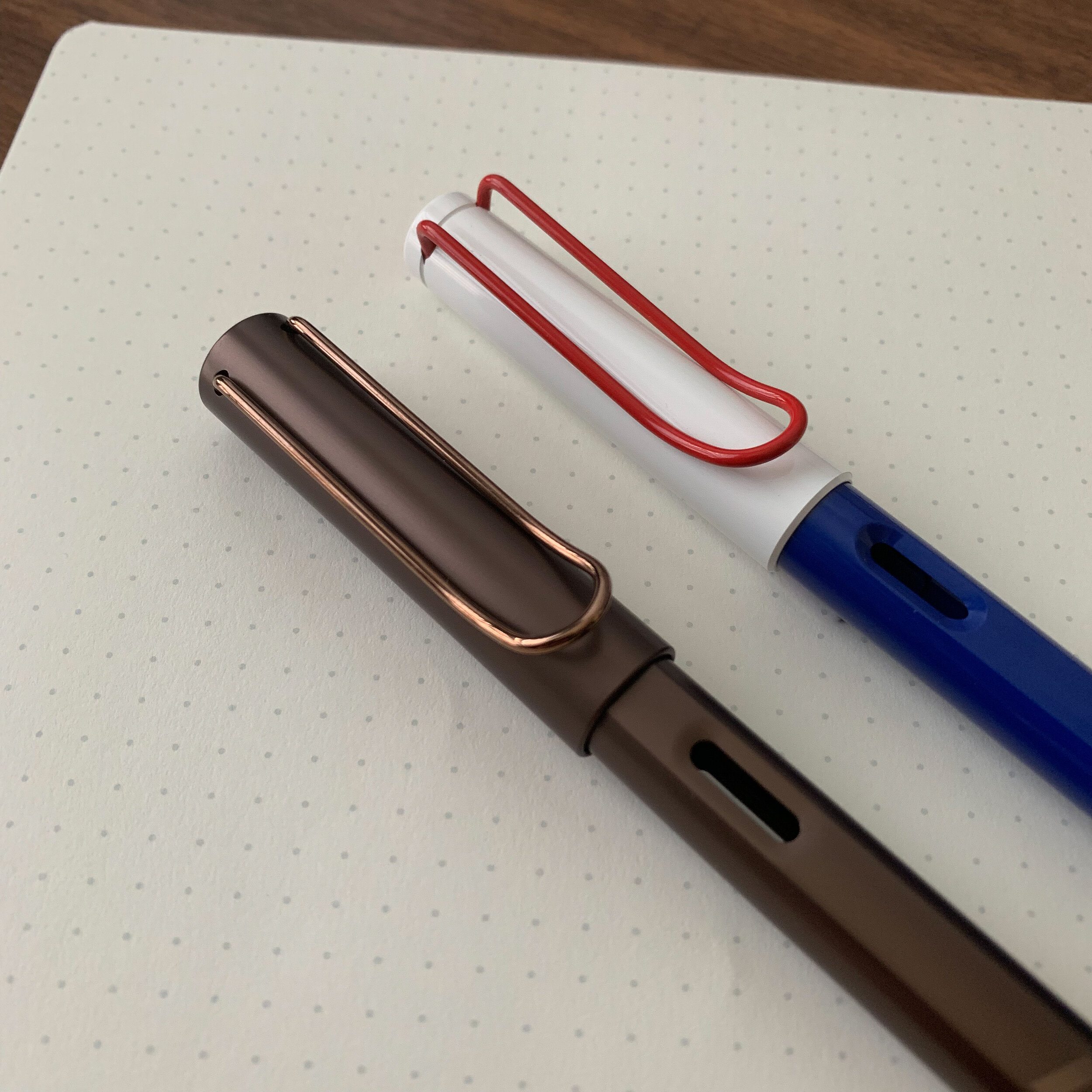 """I'll give Lamy this: their clip game is killing it. I couldn't choose between the burnished clip on the LX Marron and the red clip on the  """"Independence Day"""" Safari , so I picked up both."""