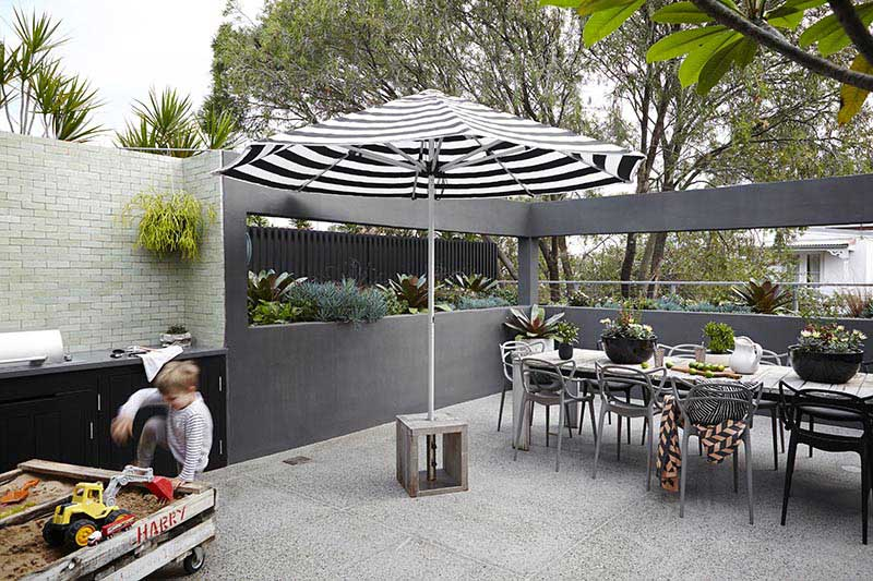 moveable umbrella which can be moved to sit in the dinning table
