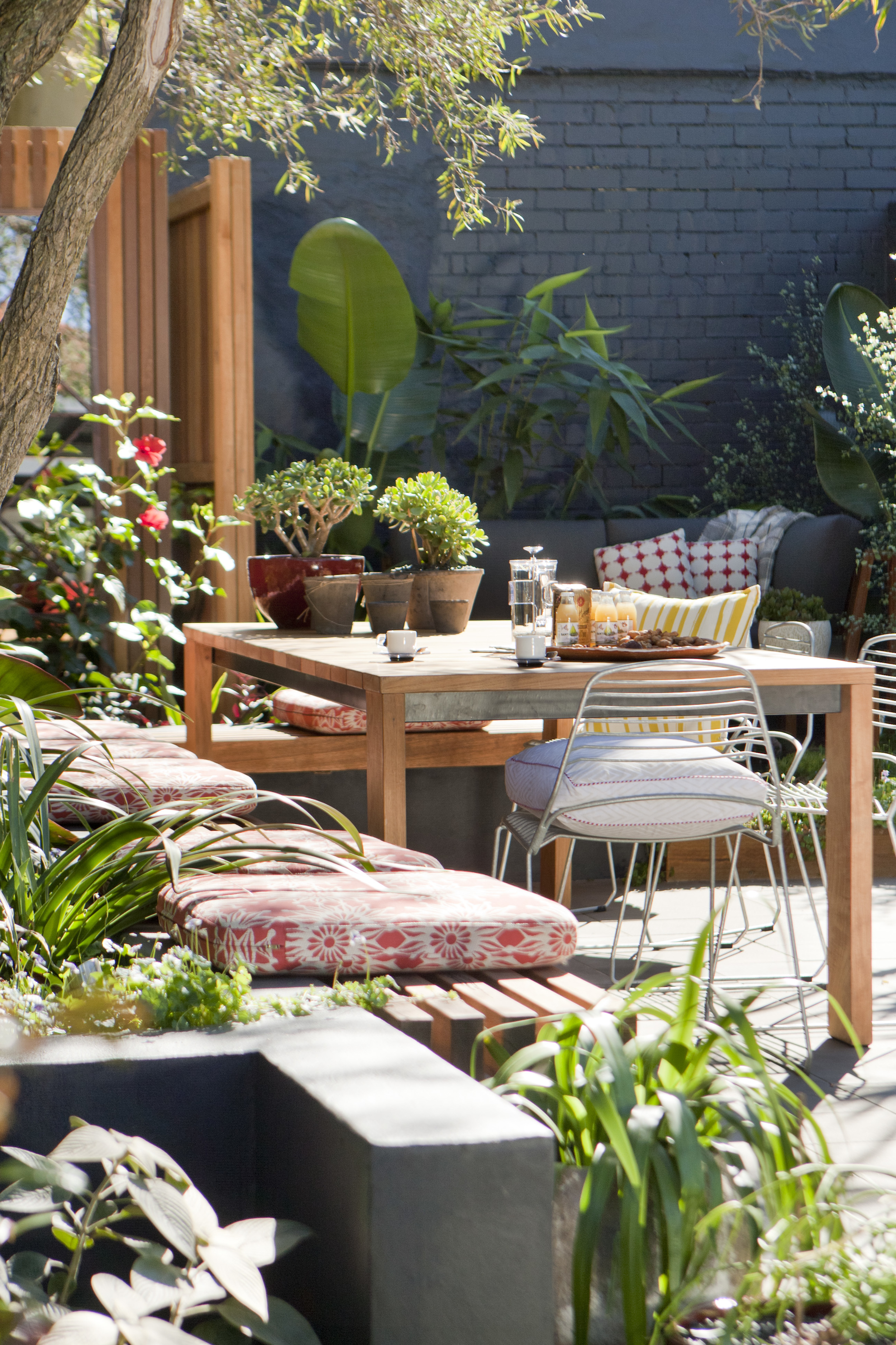 a formal dinning area bordered by a garden bench
