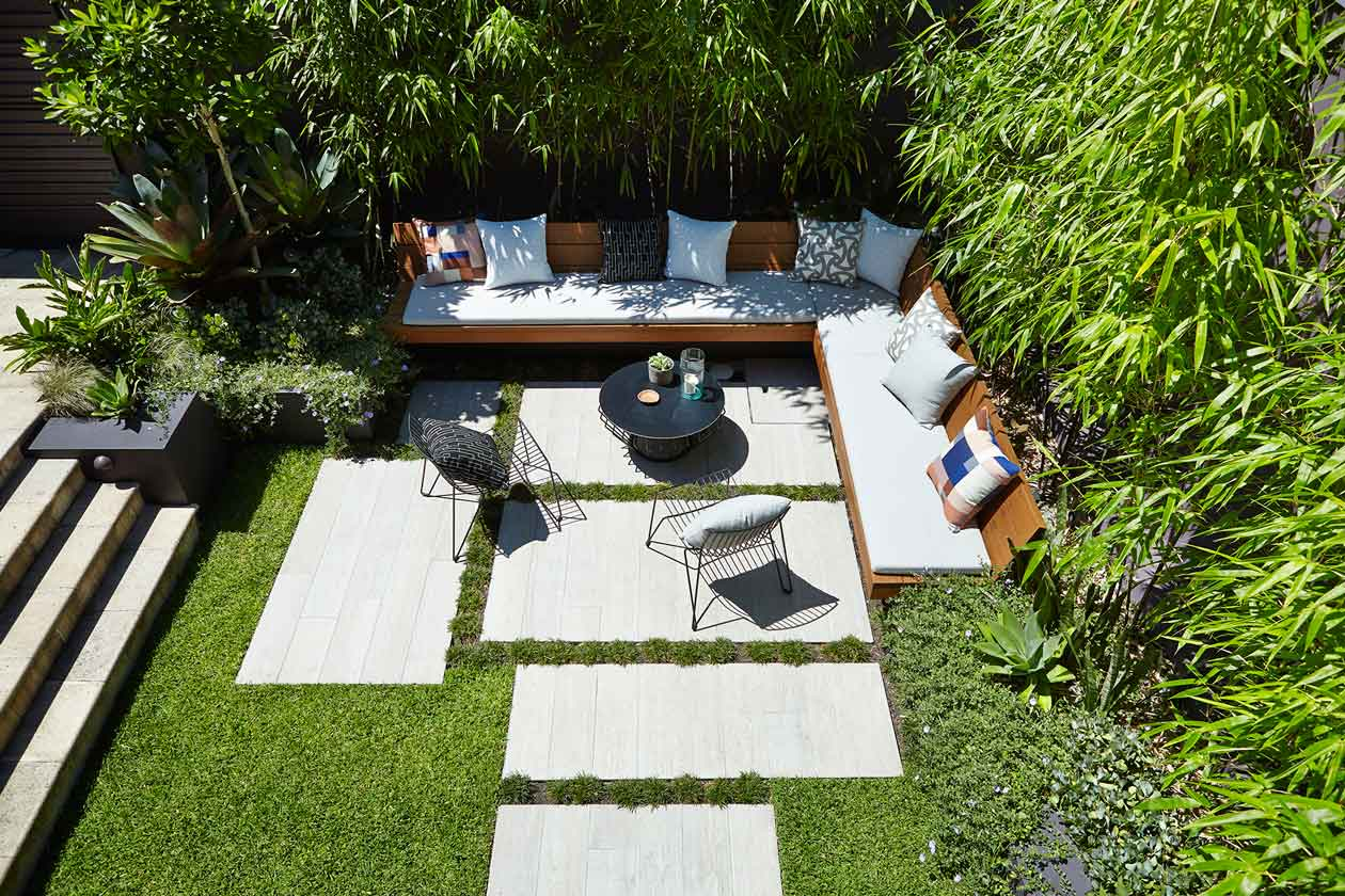 1. Darken a boundary wall to define an area and evoke a moody feel 2. Layer green-on-green to make your garden lush then add accents of coloured planting to compliment your space 3. Use oversized hardscaping or pavers to play with scale