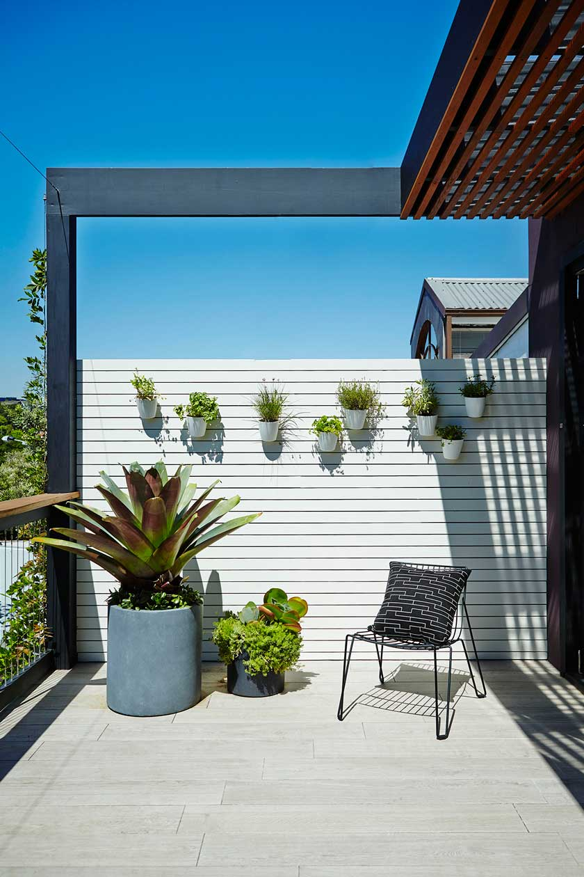 5. Add character with a garden wall and pot cluster of mixed planting