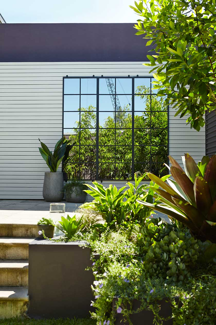 4. Accent and create depth by adding a mirror to the corner of your garden