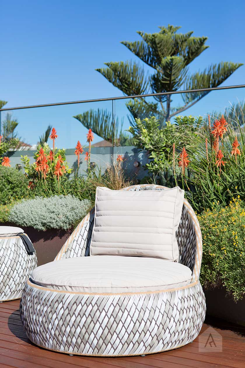 Such an inviting spot in the sun! A super comfortable chair too, with a refined and coastal colour palette.