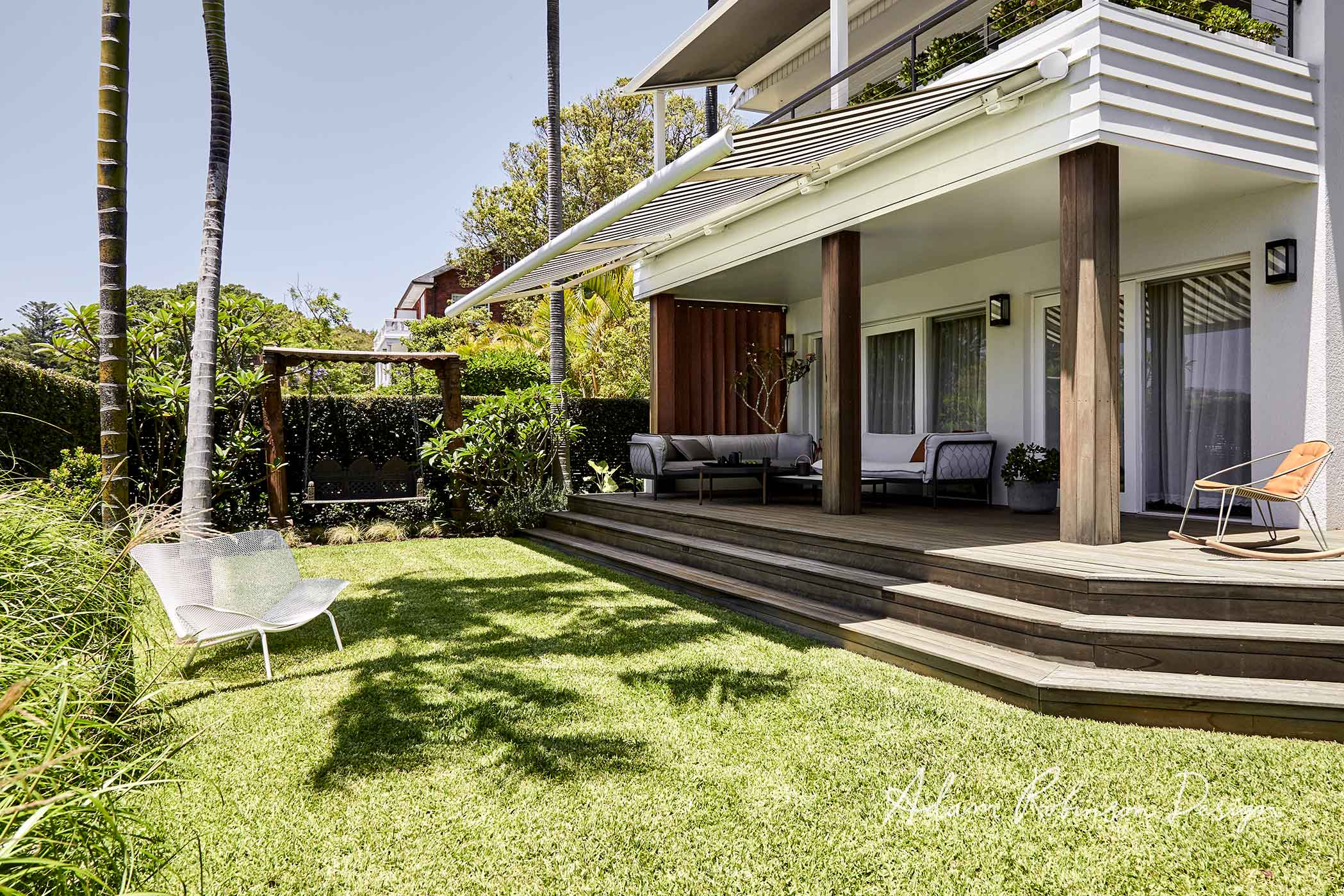 Stairs extending from this beautiful deck in to the lawn below, from our  Rose Bay project