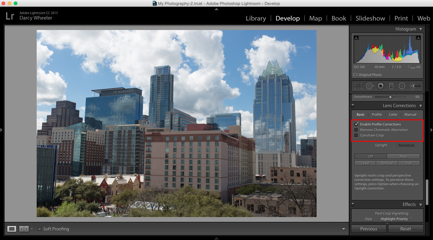 The Enable Profile Corrections feature can be found in the Develop menu in Photoshop.