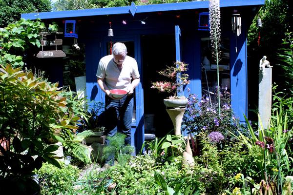 Me outside my garden studio.