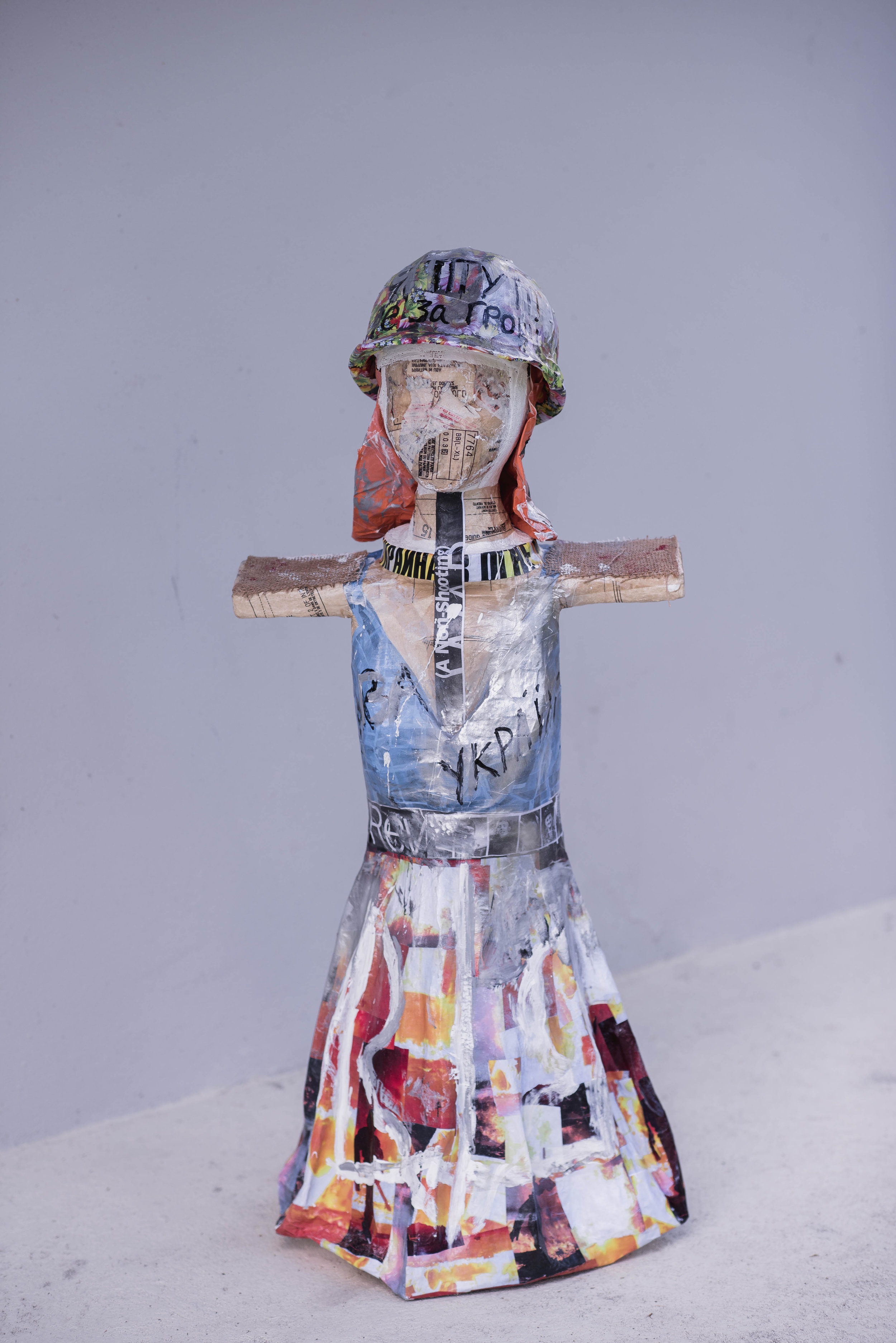 Ode to Kyiv  1.0 x 0.5 meters, 2018 Paper mache, plaster of paris, styrofoam, cardboard, acrylic paint, paper, duct tape, wires, fabric, spray paint, burlap, and plastic helmet