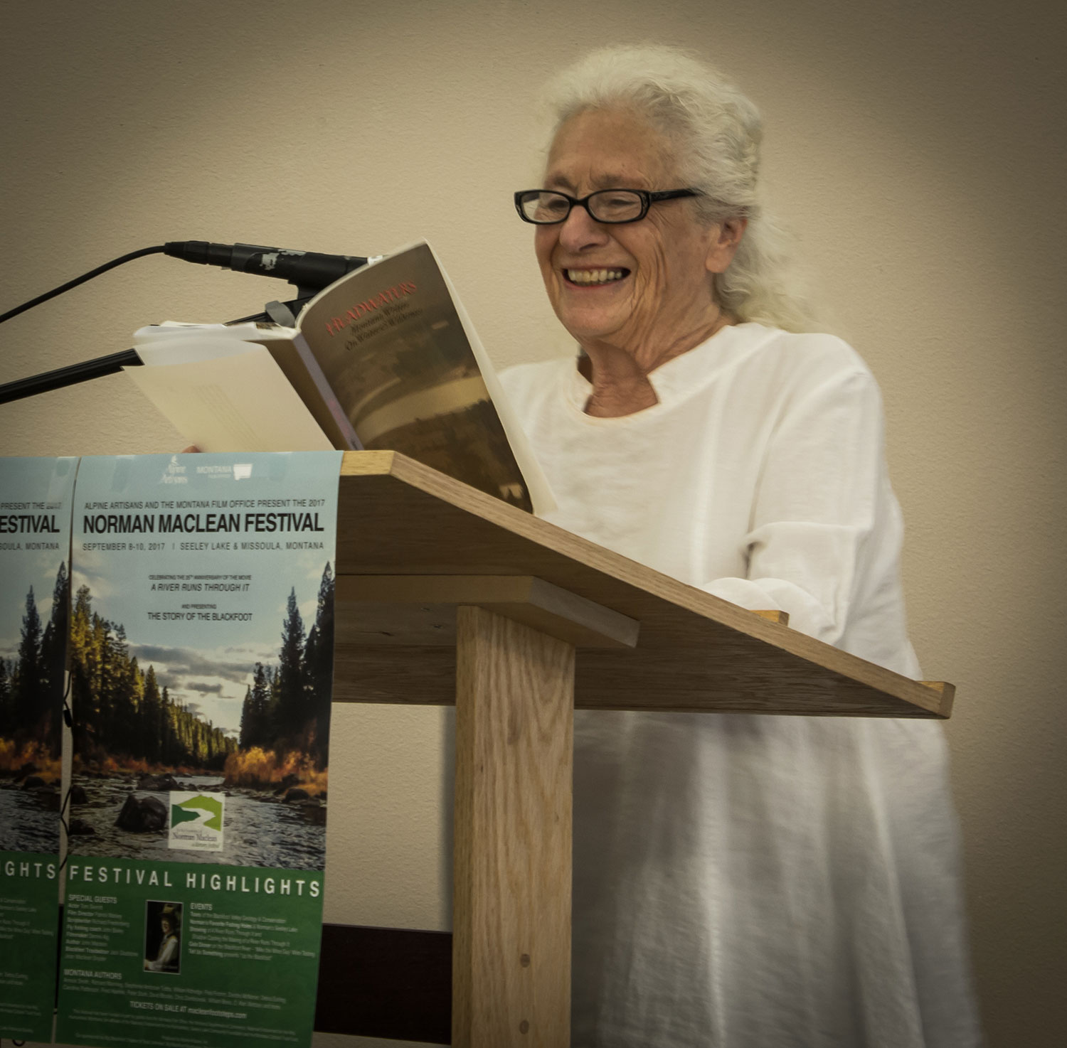 Annick-at-Podium-reading.jpg