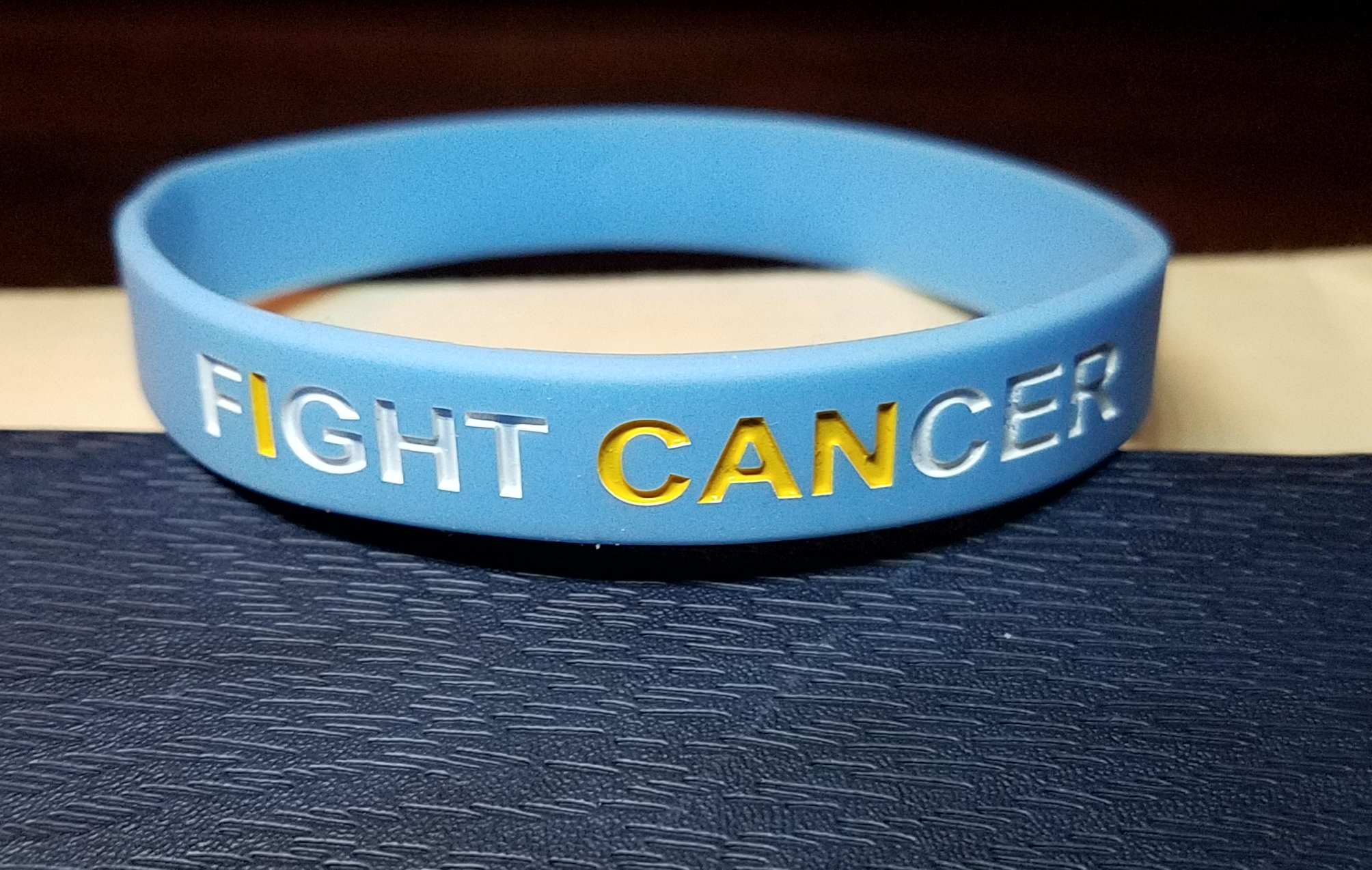 I often wear This wristband from the cancer center where i'm being treated.