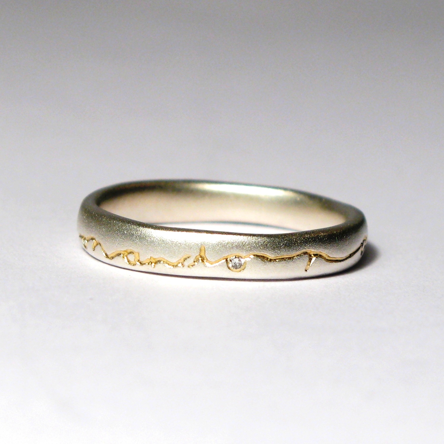 Silver ring with 22 carat gold etch and 0.01 carat diamond