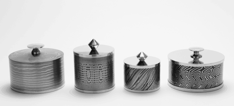 Pattern-welded lidded boxes by Mick Maxen, from a selection on display