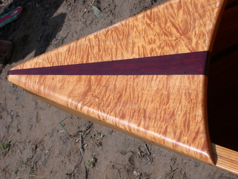 The deck is figured Maple with a Paduk inlay