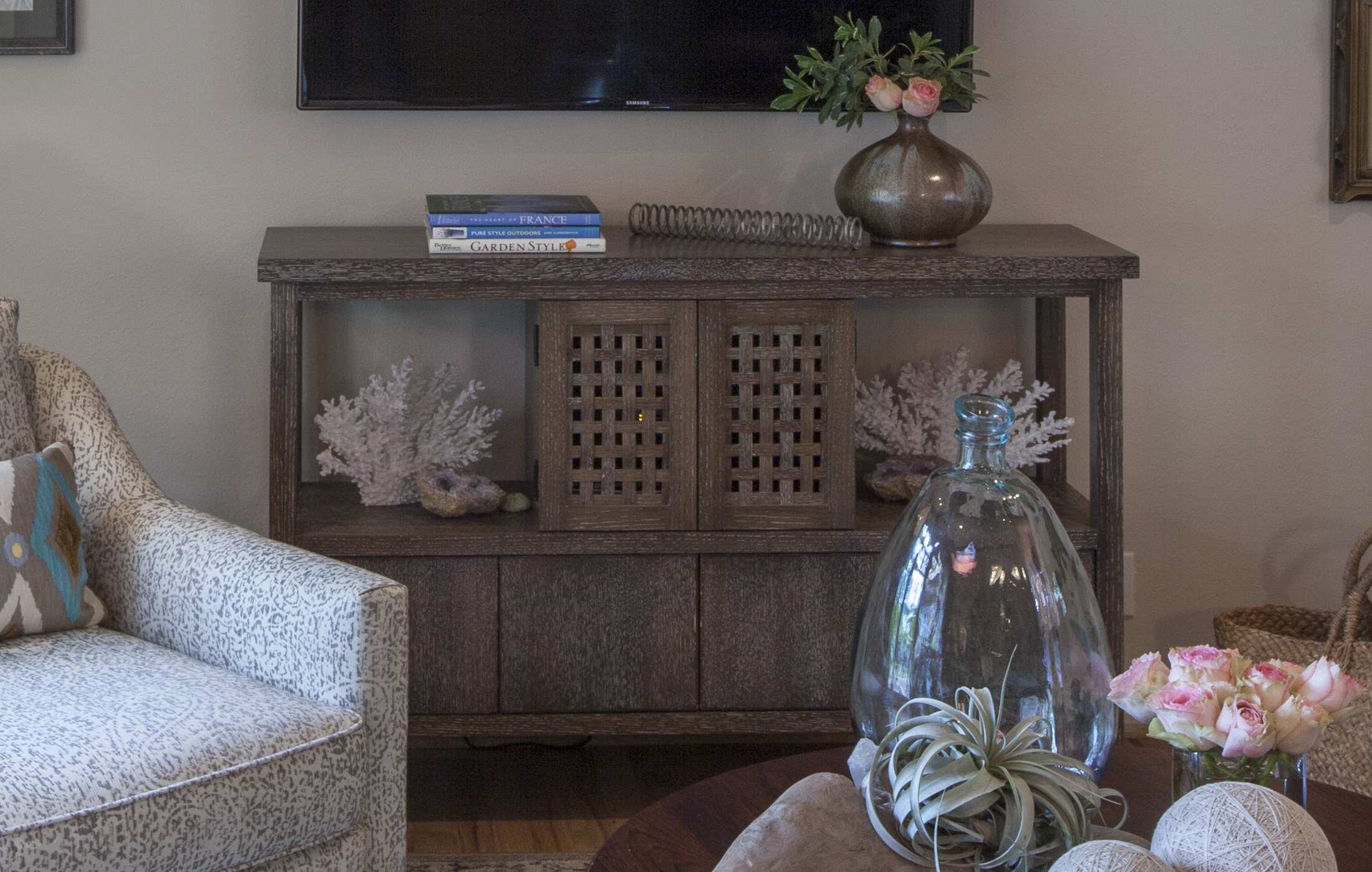 """Designed and produced by Michael Reznikoff, this living room side-board/credenza holds the electronics which power contemporary audio-video or media displays. The notable """"basket-weave"""" design of the doors allows infrared signaling from a remote control to reach - and """"talk"""" - to the various electronic units. (Rift-cut white oak with a ceruse finish)"""
