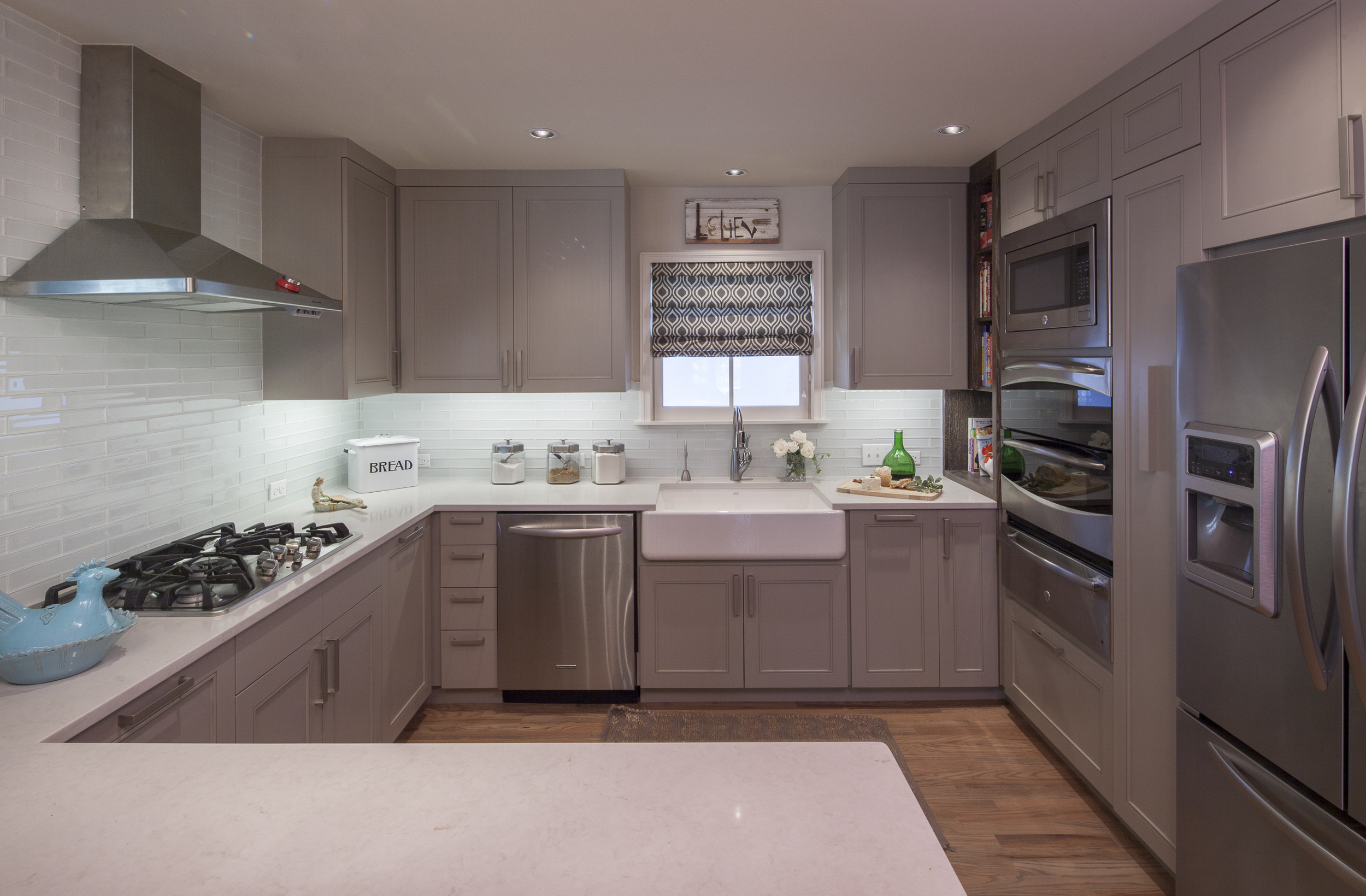 """Kitchen overview #1. Note the sink style (called a """"farm sink"""") - and itsemplacement - which allows food prep around a horseshoe arrangement and counter cleaning to be managed easily with a simple sweep into the sink."""
