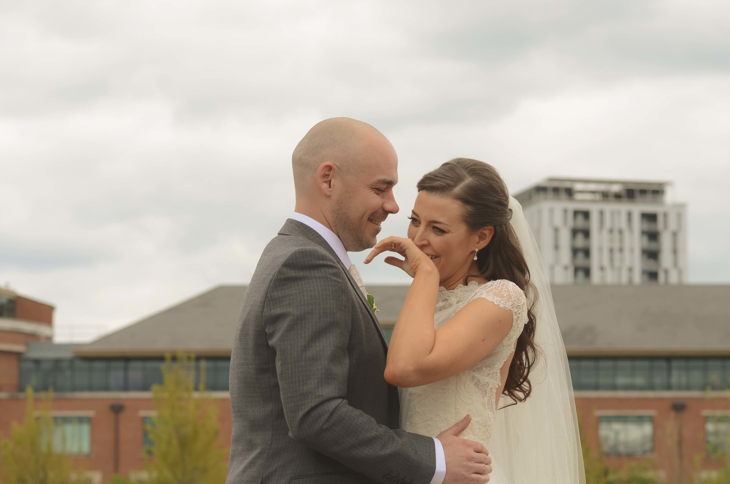 Bride and groom laughing at Salford Quays