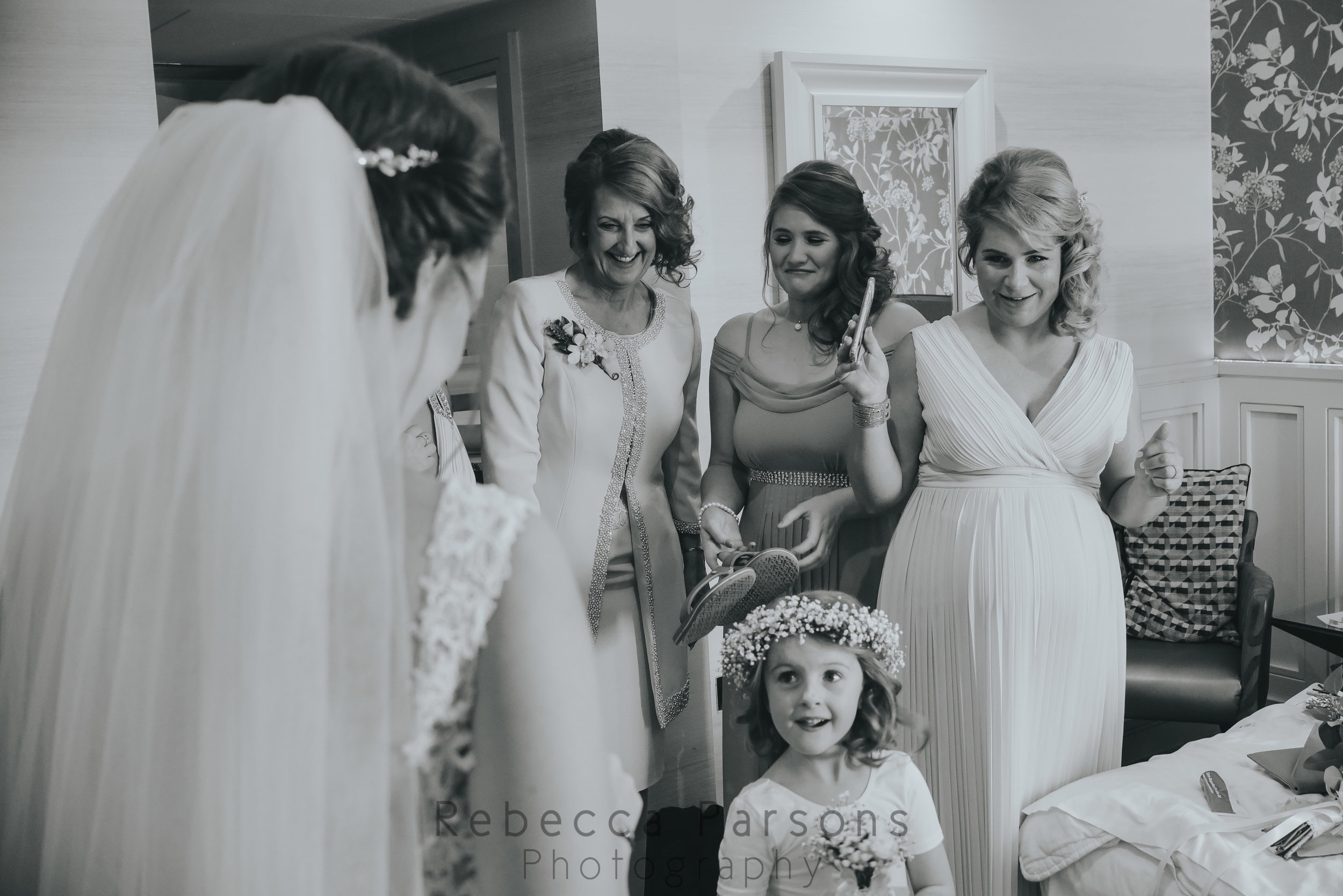 Bridal party seeing the bride in her dress for the first time
