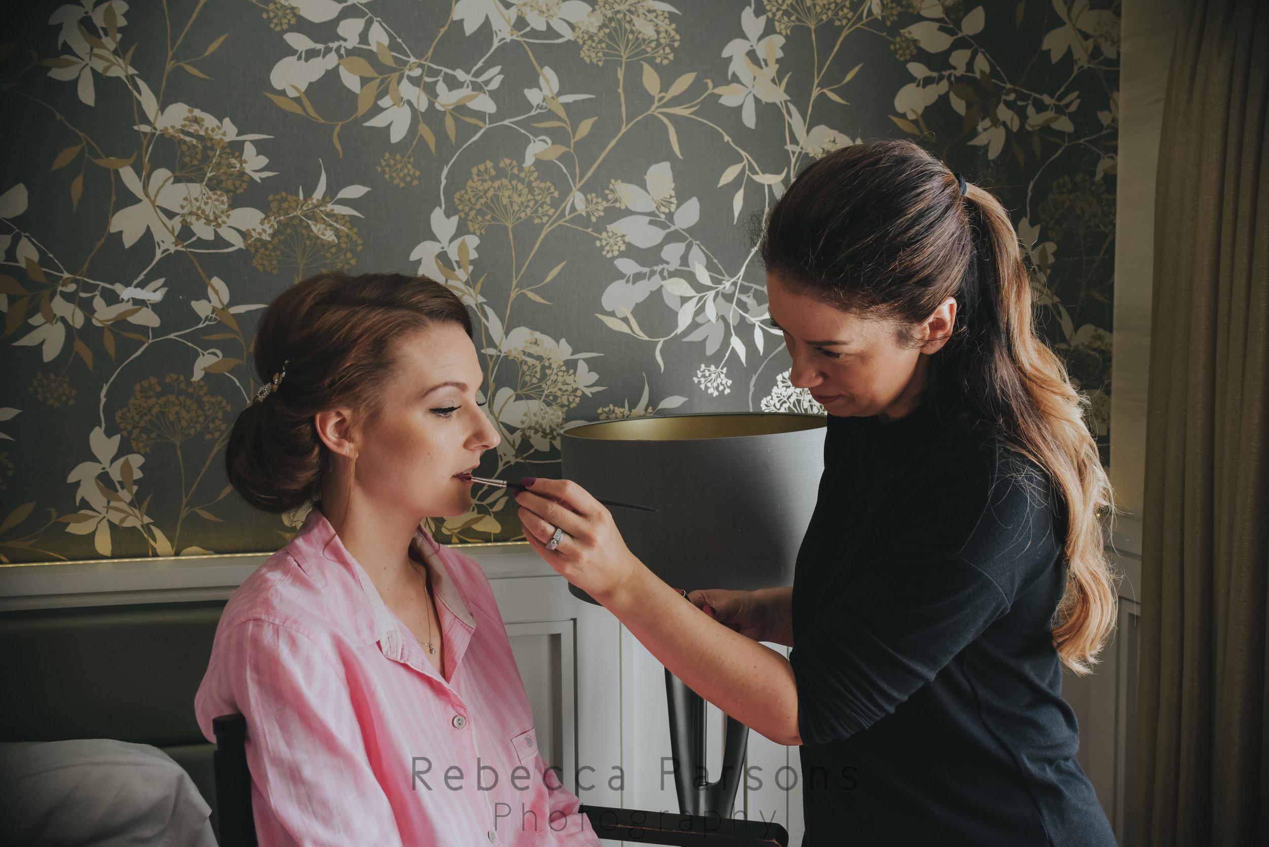Bride make up being finished