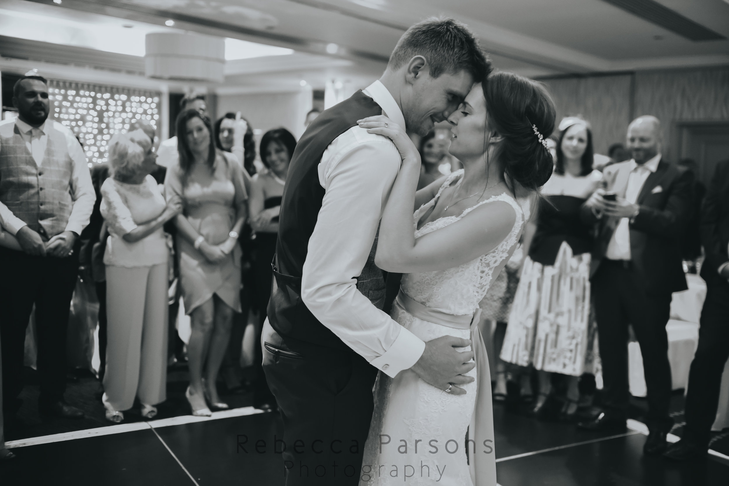 Bride and groom with faces touching during first dance