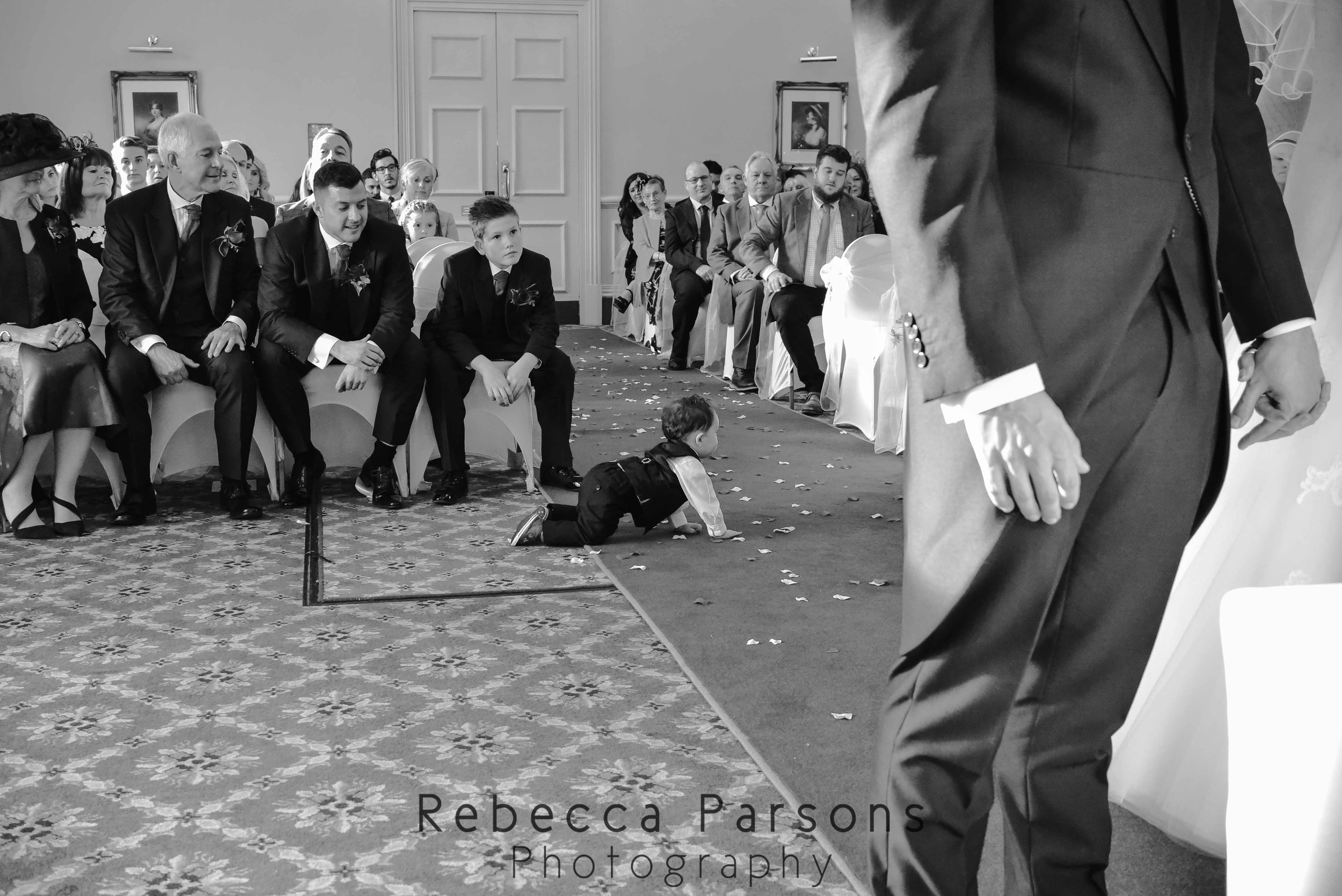 baby crawling across the room black and white