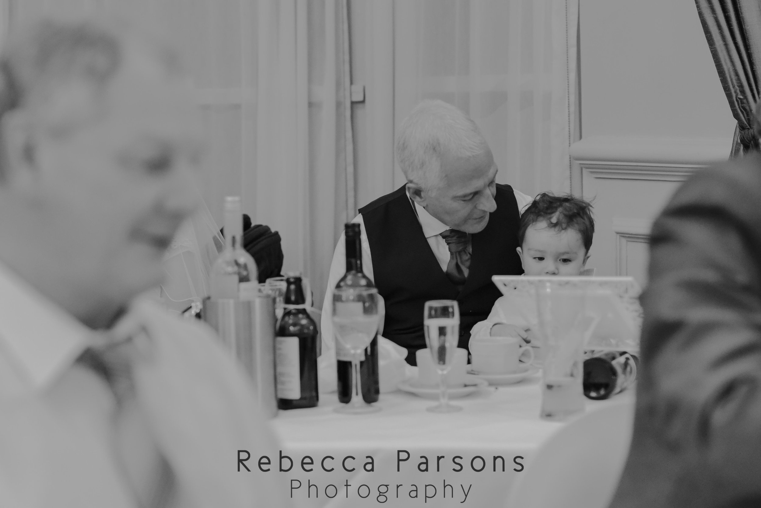 grandad and grandson at table black and white